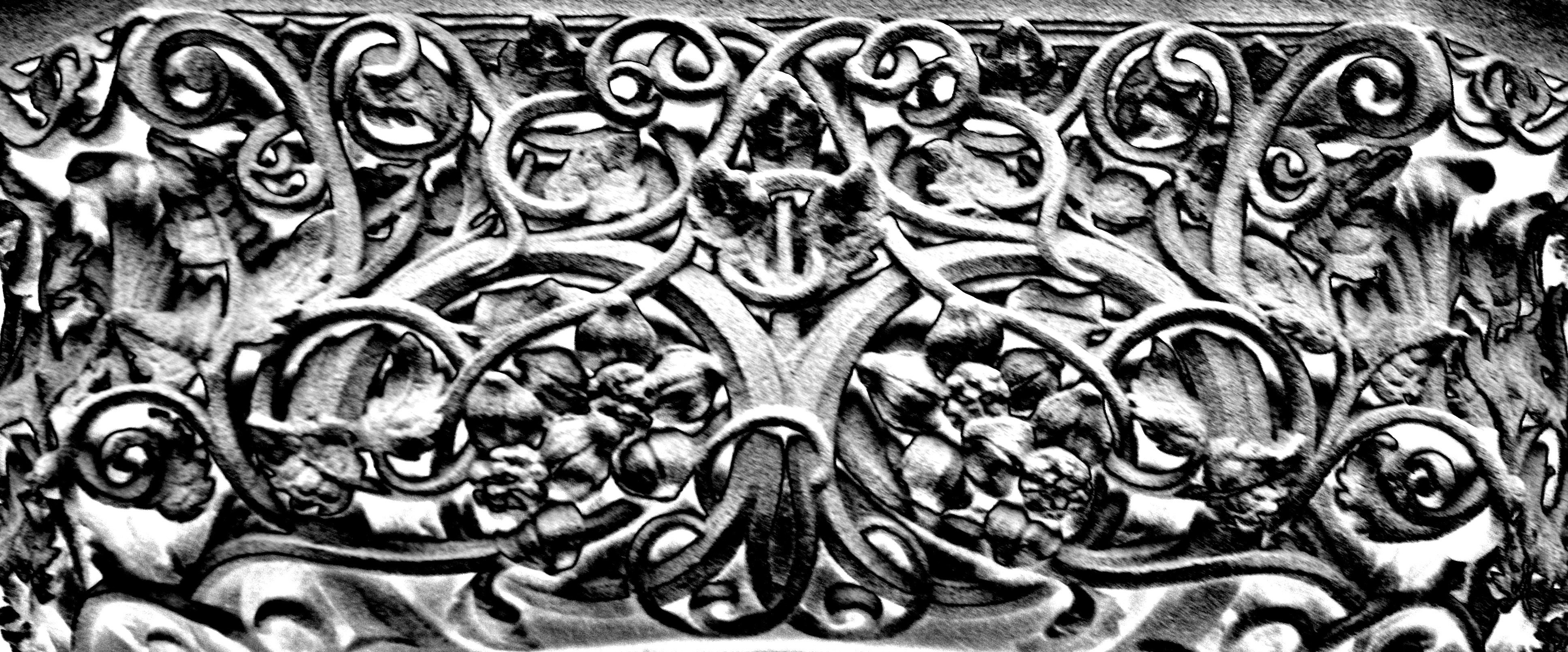 scrollwork patterns in stone carvings