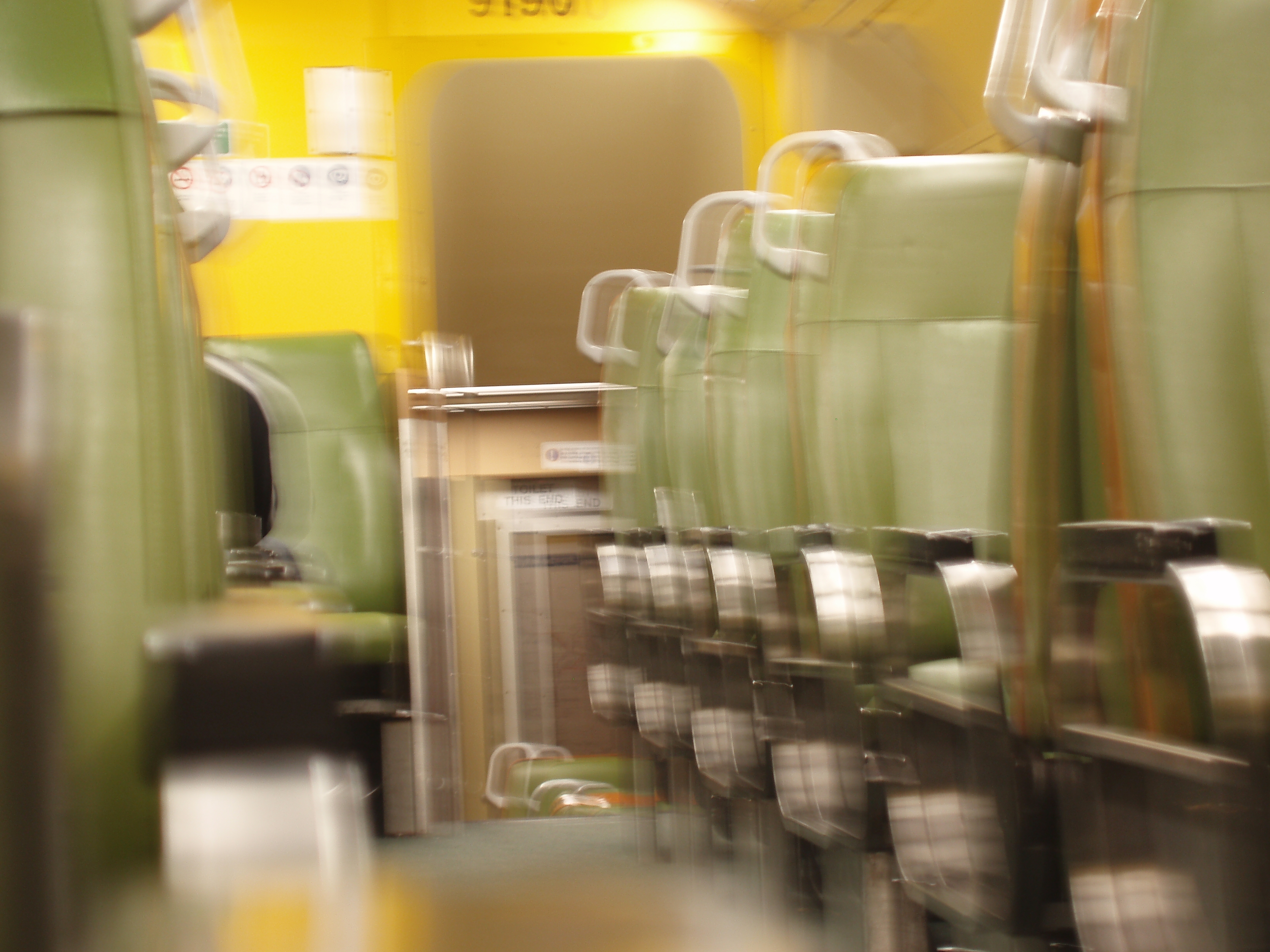 abstract blurred interior of a train passenger car
