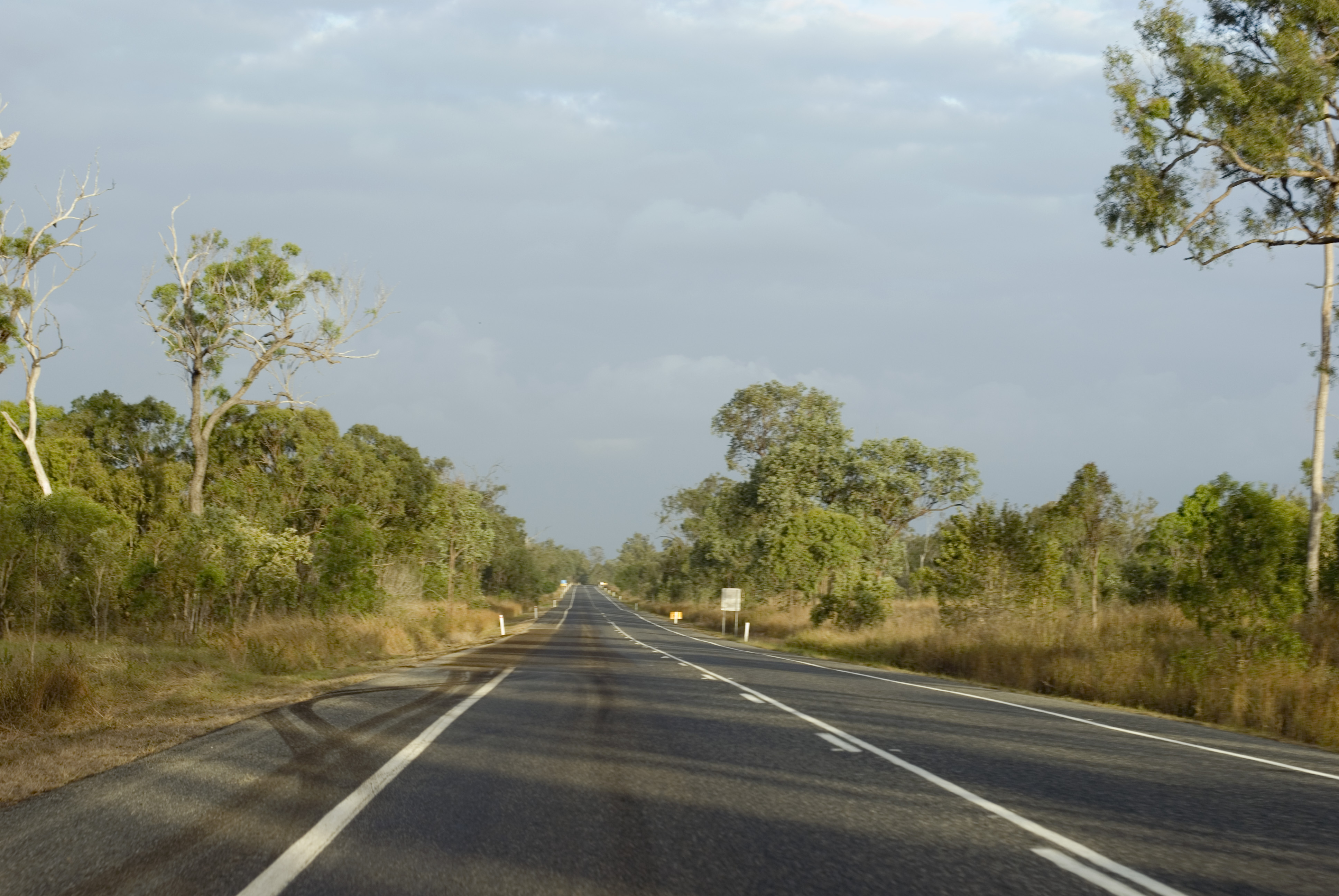 motion blurred view of a long straight highway in queensland, australia.
