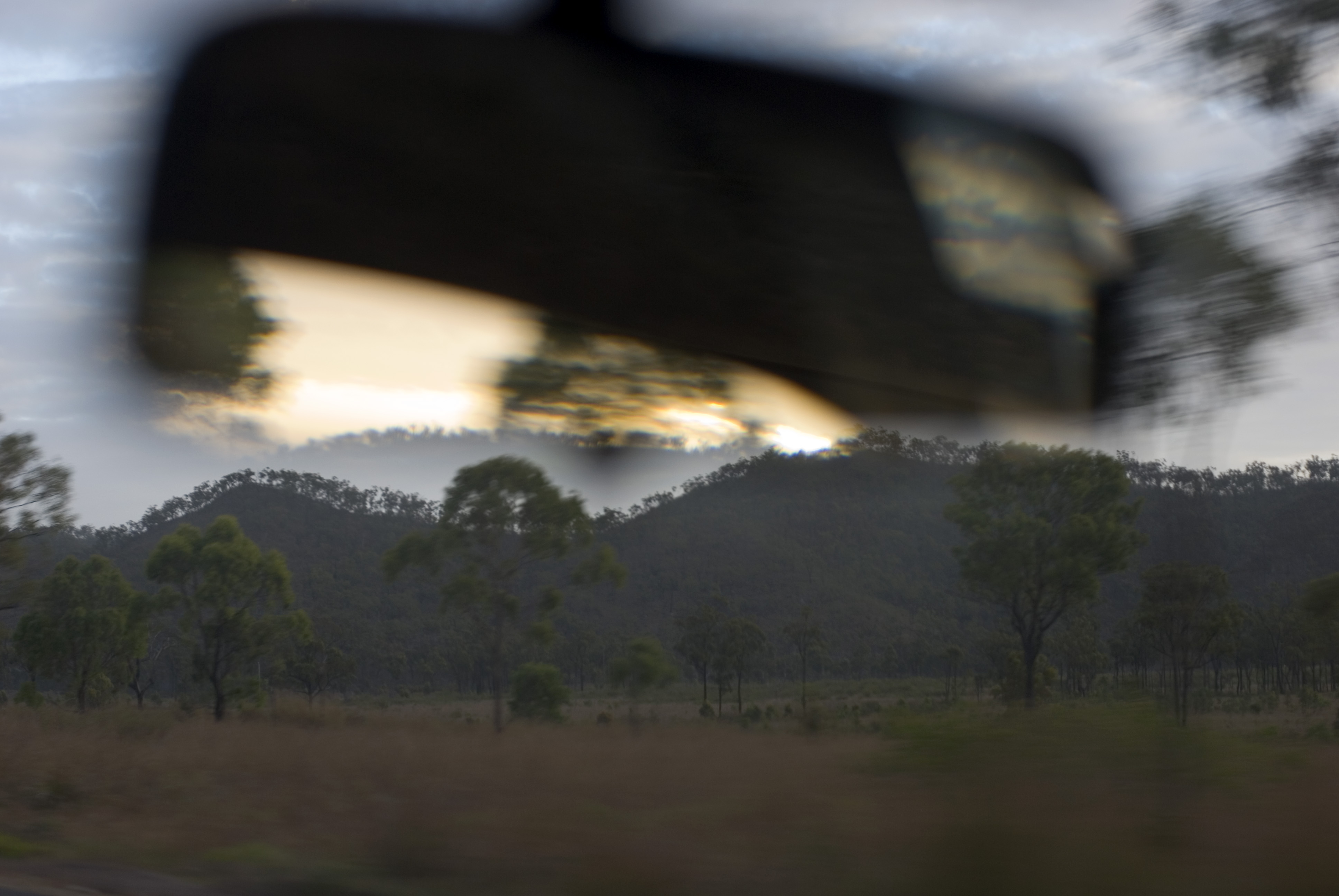 abstract blur in a rear view mirror austrlian landscape