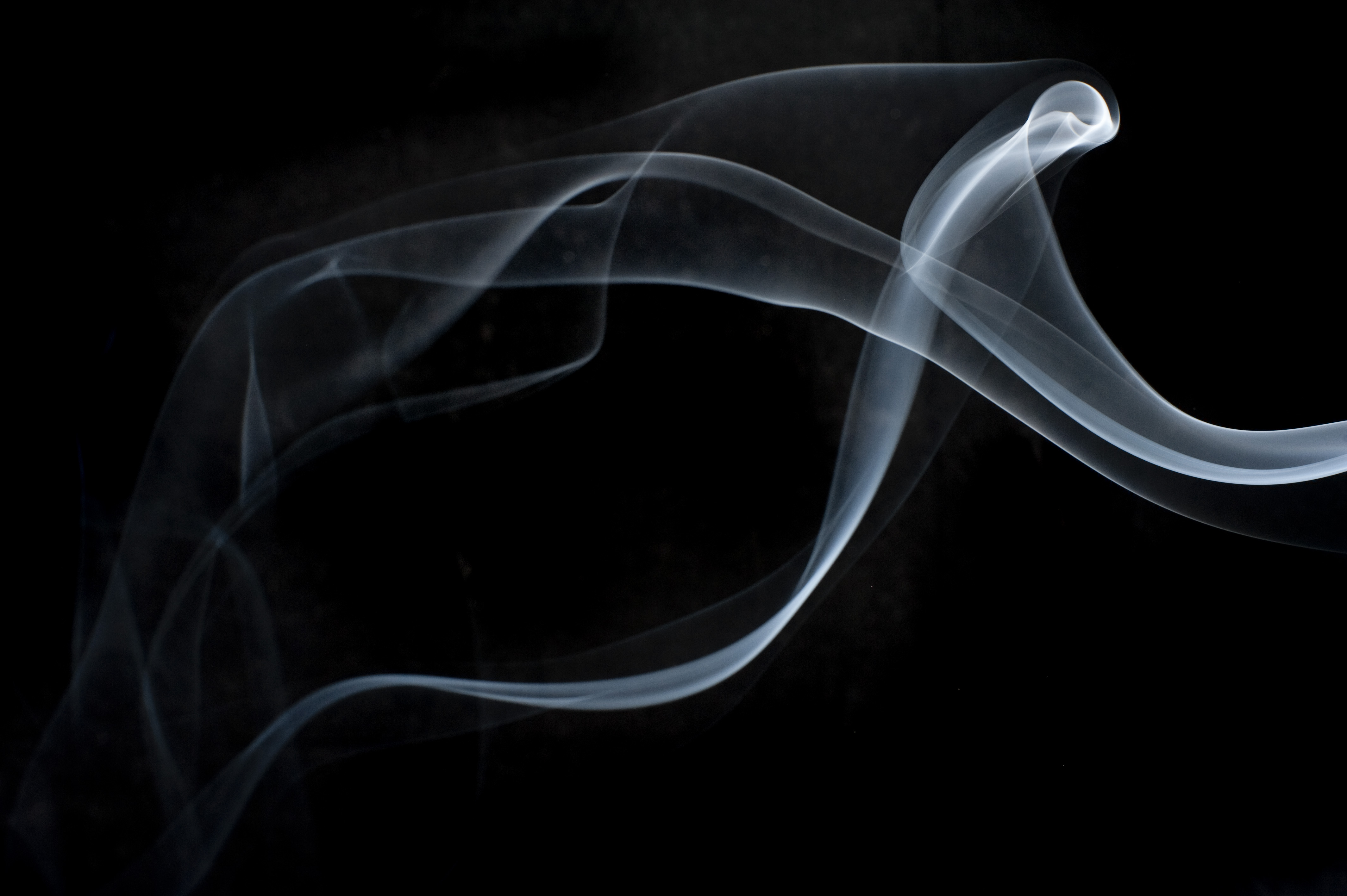 a background of mystical layers of smoke on black