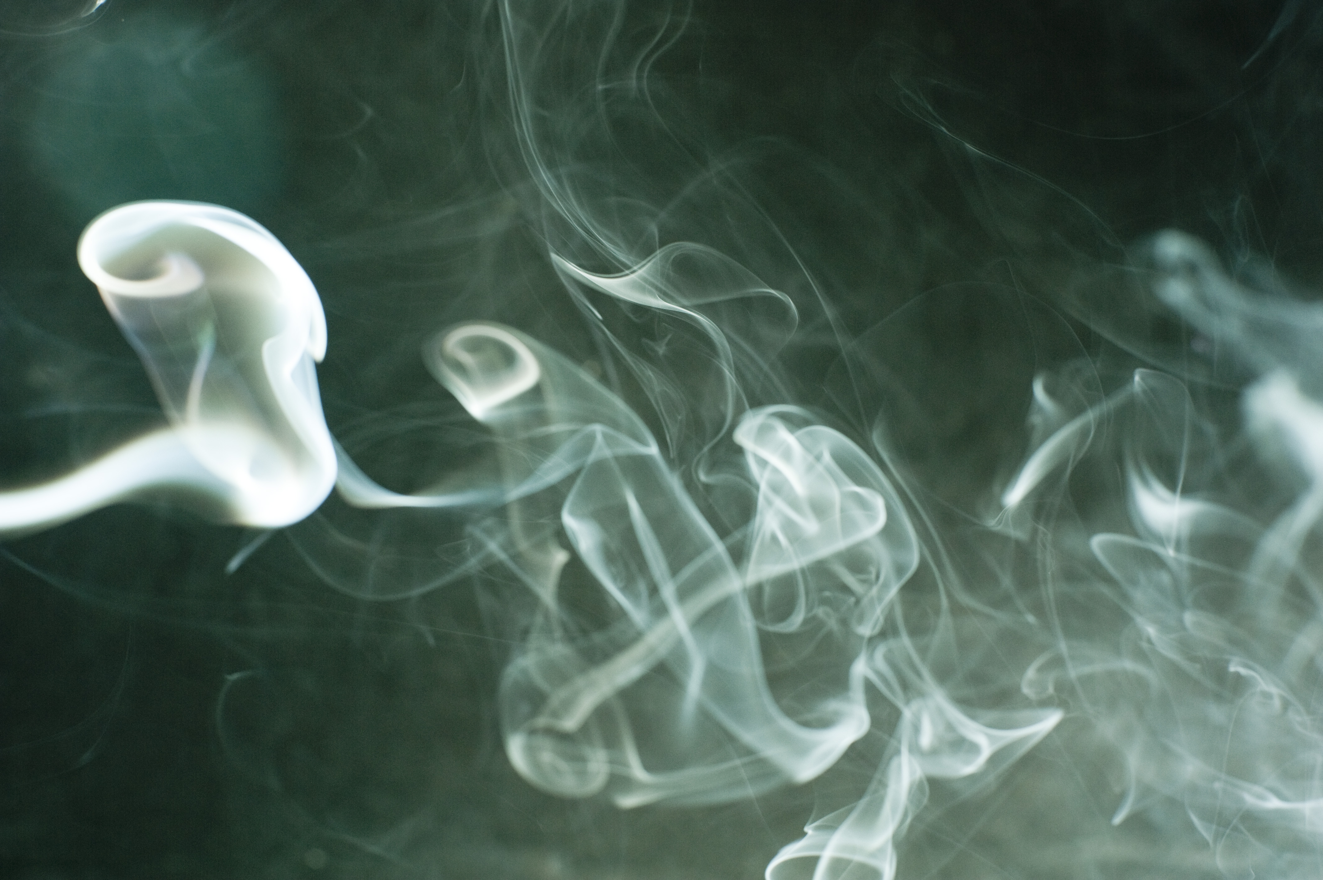 a misty smoky effect background with swirls of defuse smoke vapour