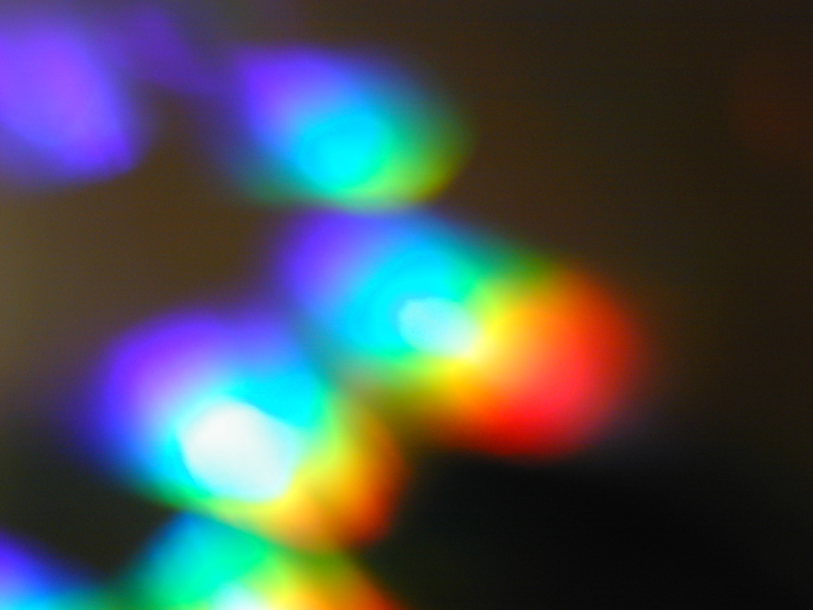 abstract soft focus ethereal image of rainbow coloured lights