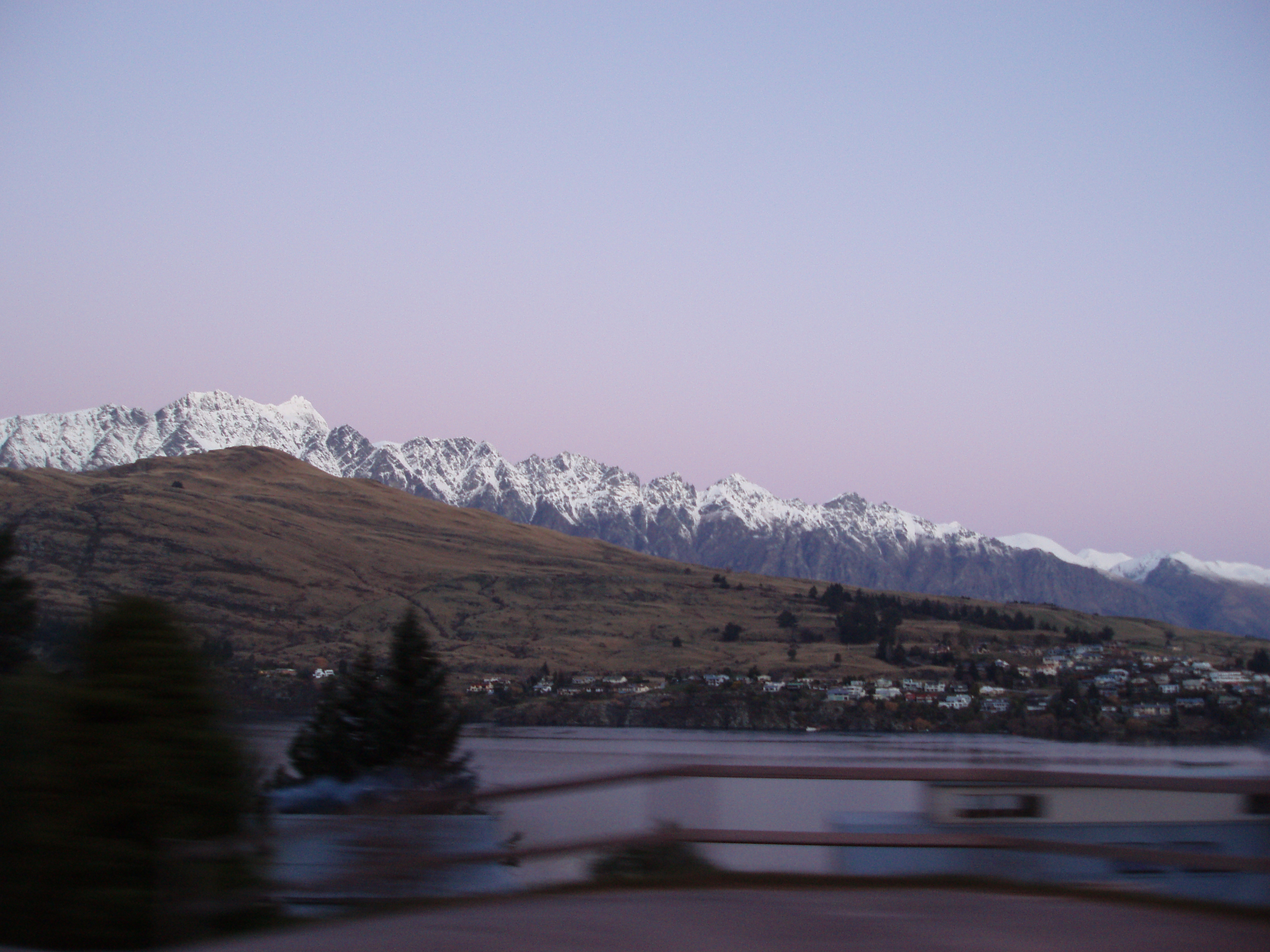 remarkables mountains range at dusk capped with winter snow
