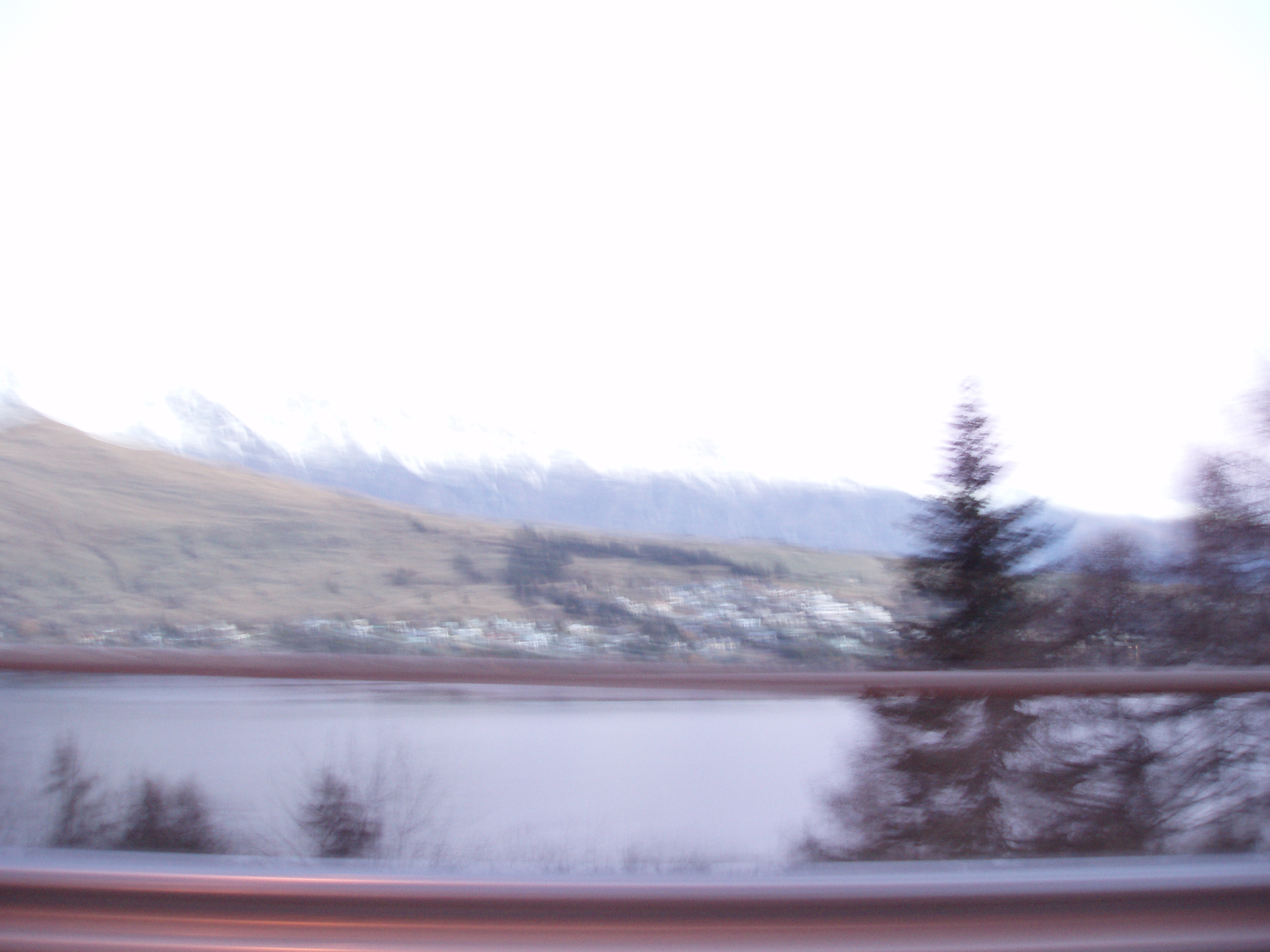 high key burnt image of the mountains around queenstown newzealand with motion blur