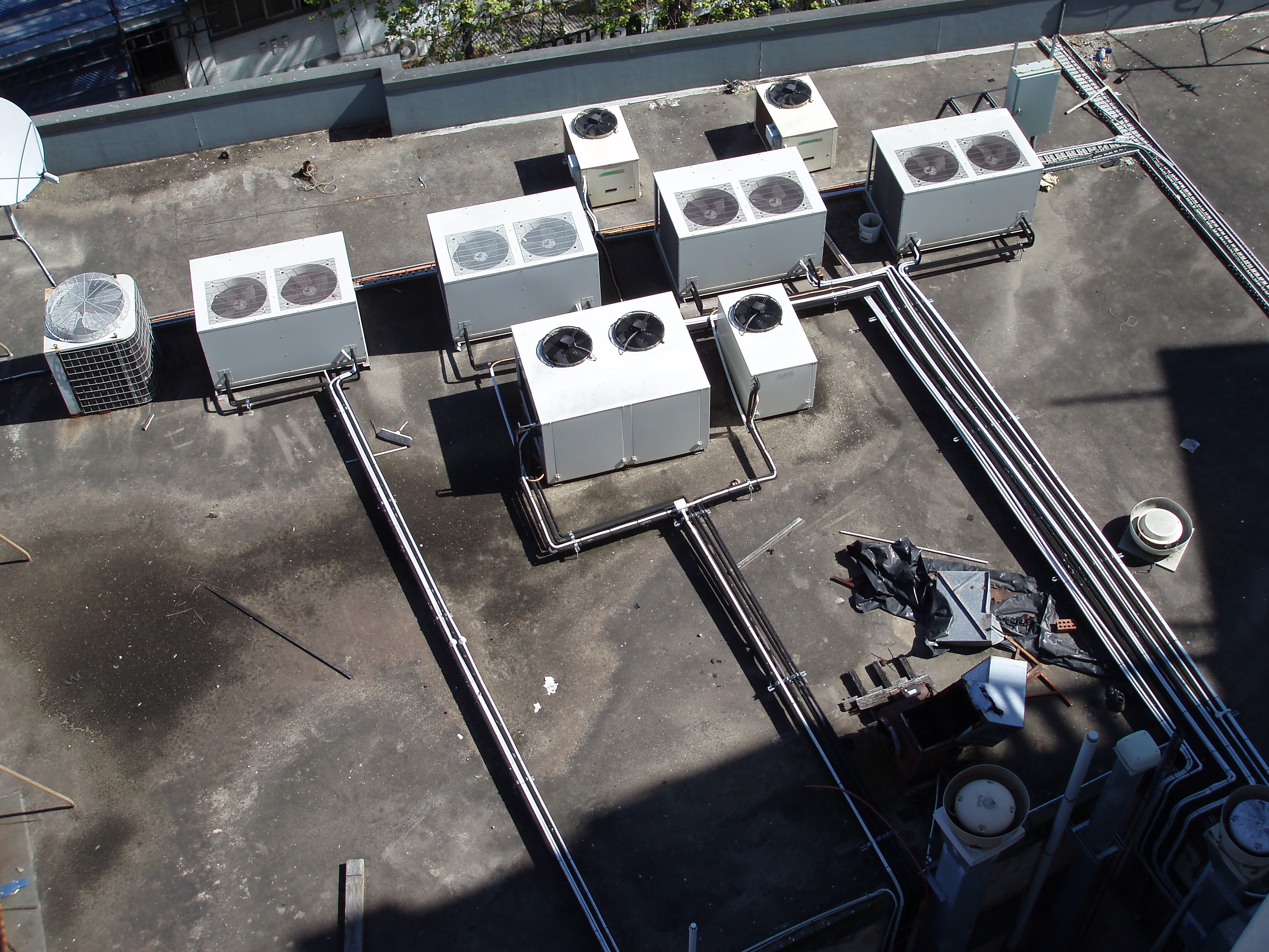 looking down on a rooftop full of airconditioning equipment