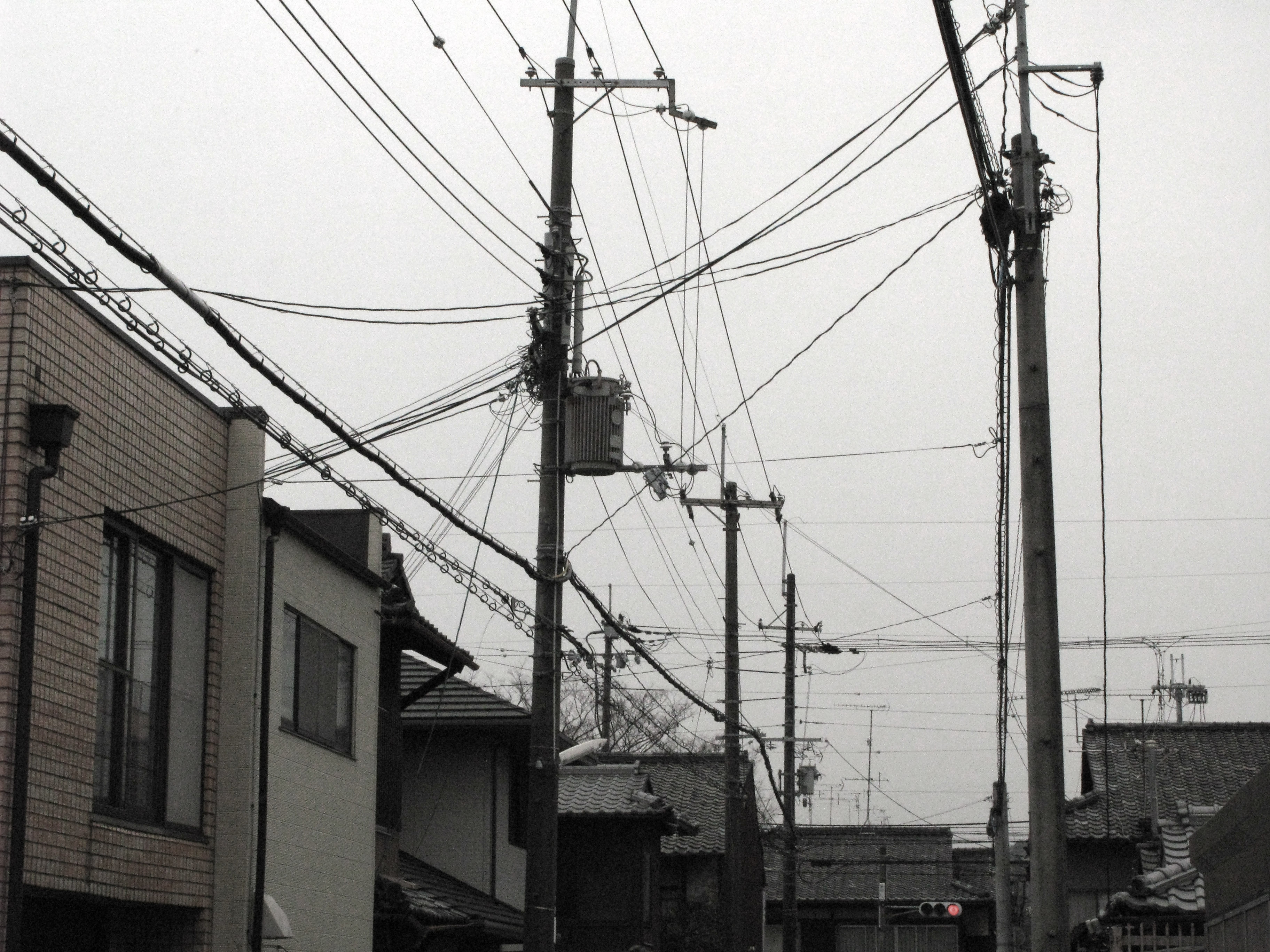 typical japanese street scene with power cables strung in all directions