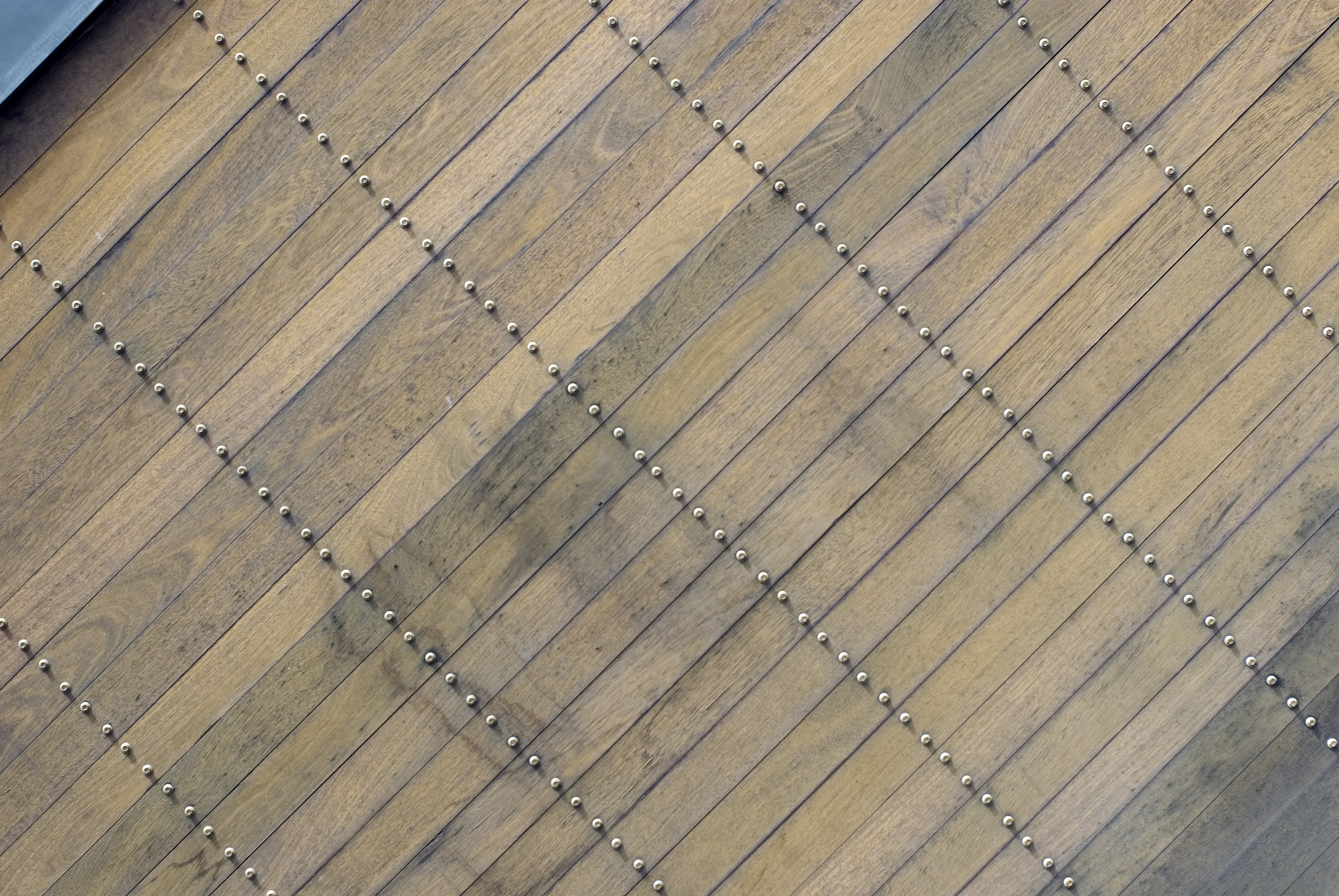 texture of a wooden surface with lines of screws