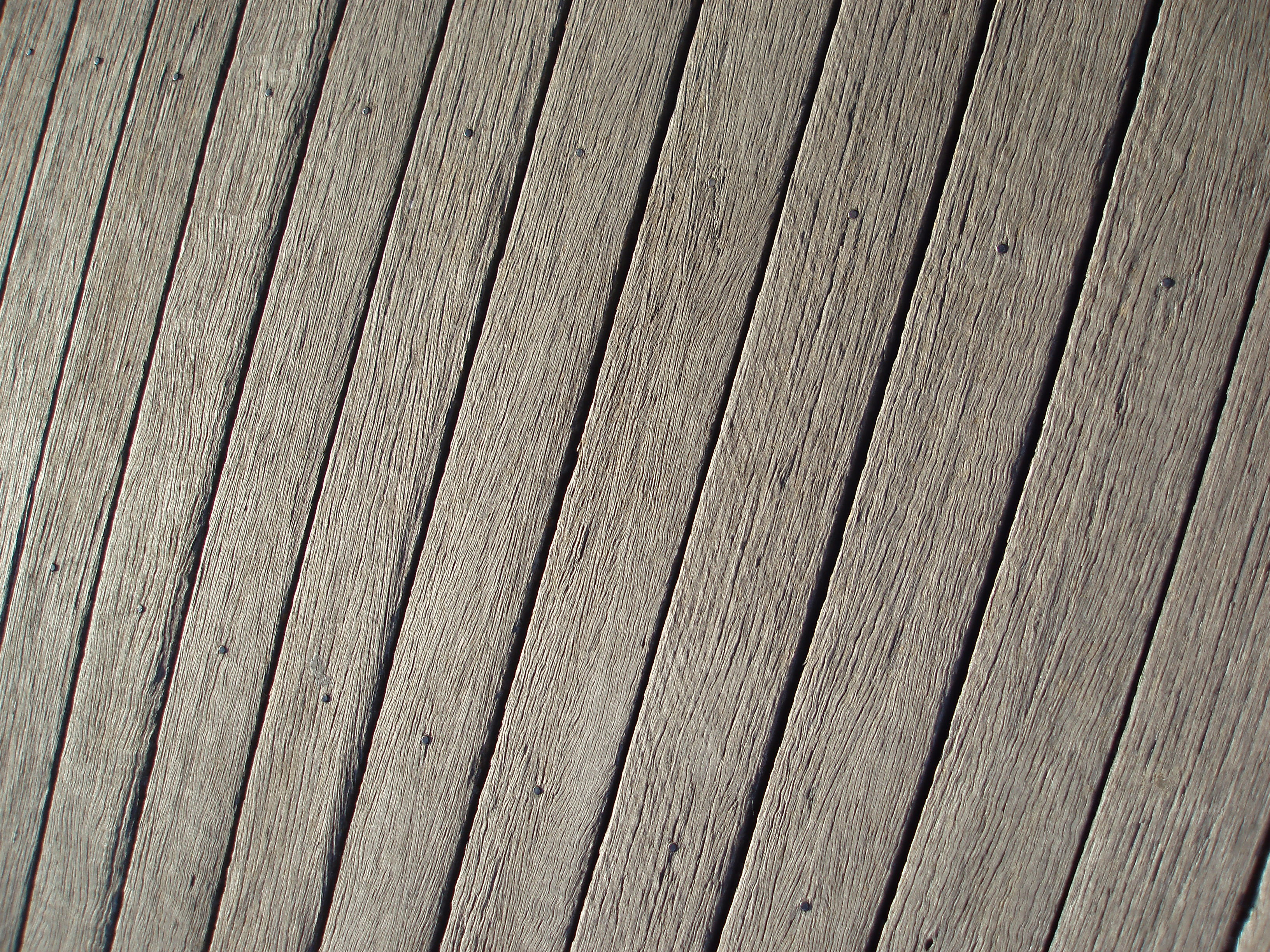 wooden decking with jet washed and sun bleached surface