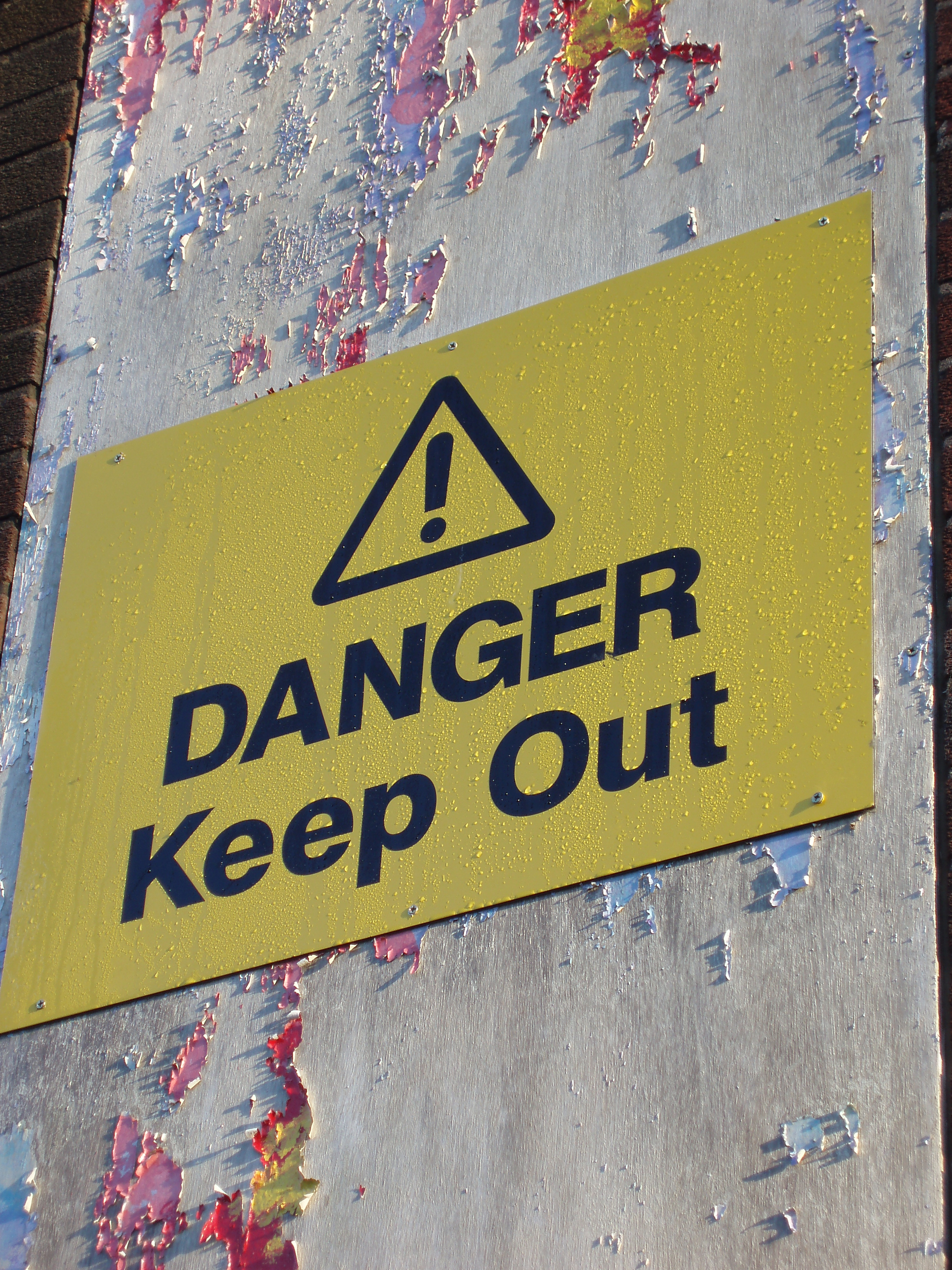 weathed paint and a danger keep out sign