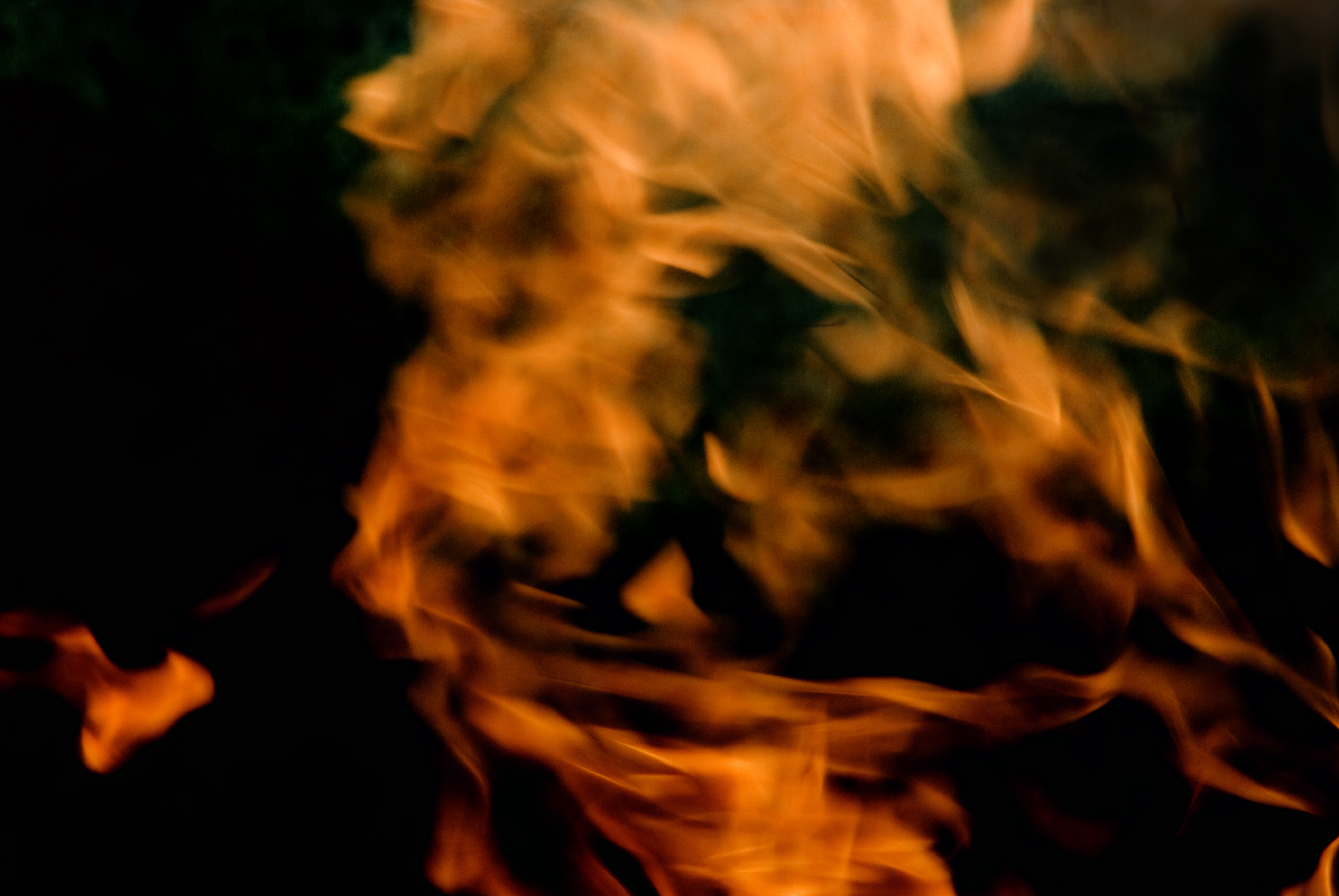 background of blurred burning flame on black