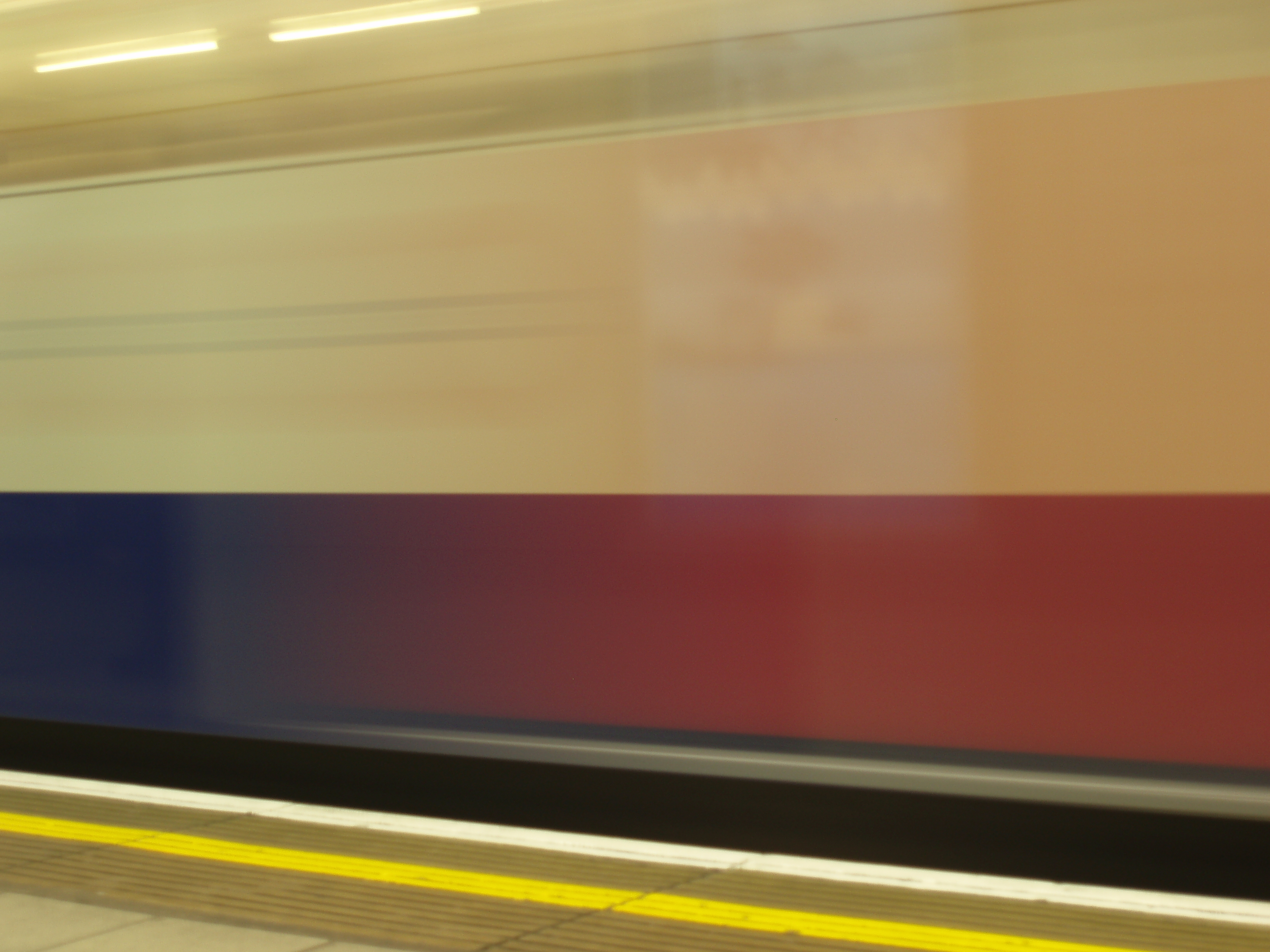 abstract image of a train passing a platform
