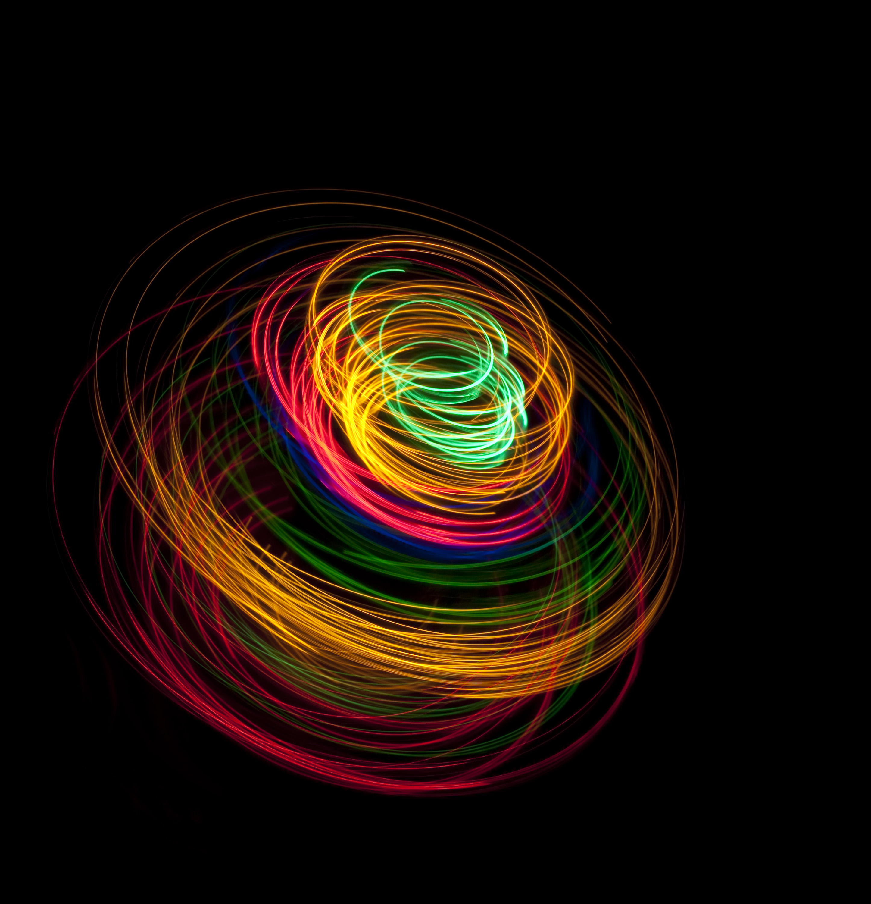 colorful light traces creating a 3d rotating effect