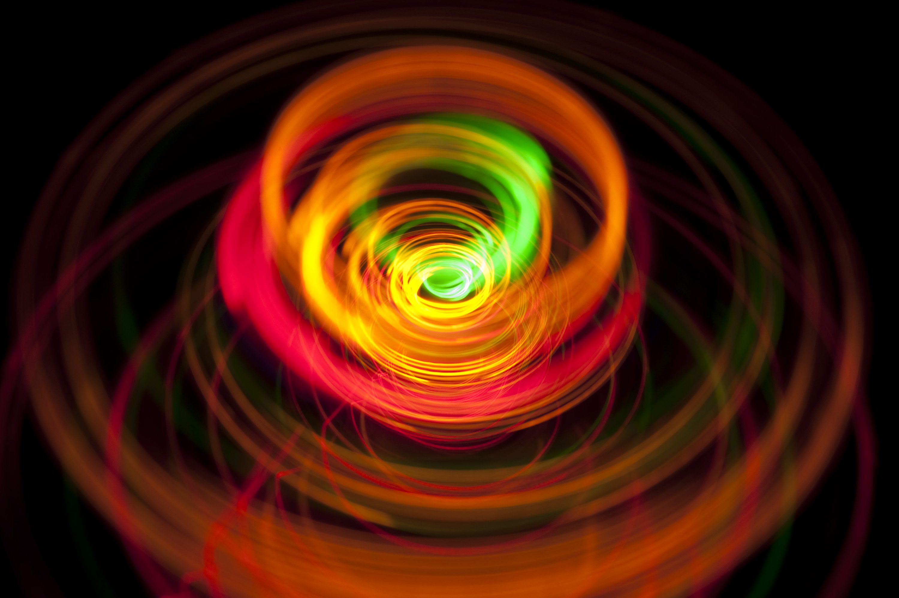 a catherine wheel firework effect of vividly coloured light