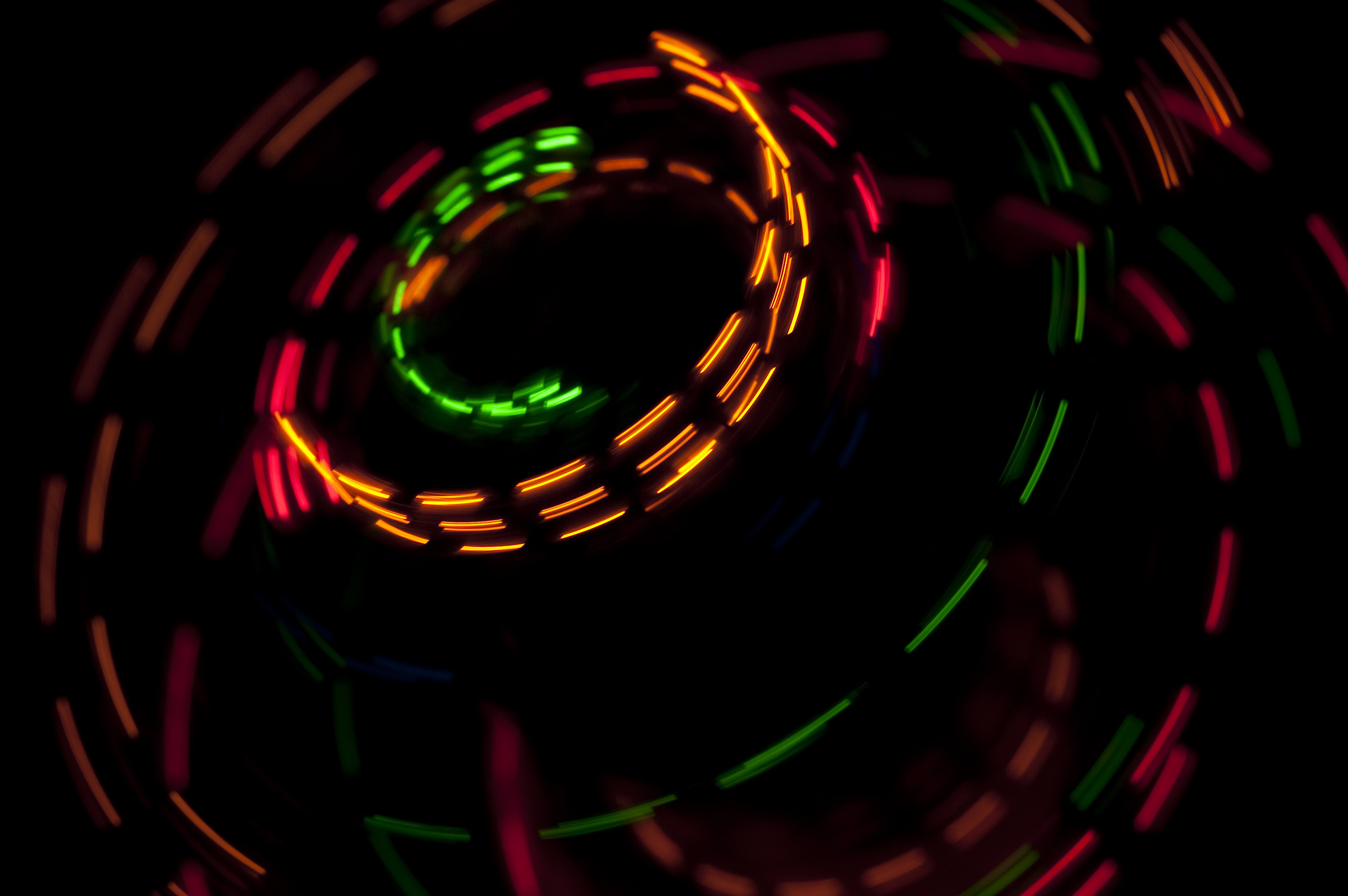 colorful dashed lines of light creating a circular pattern