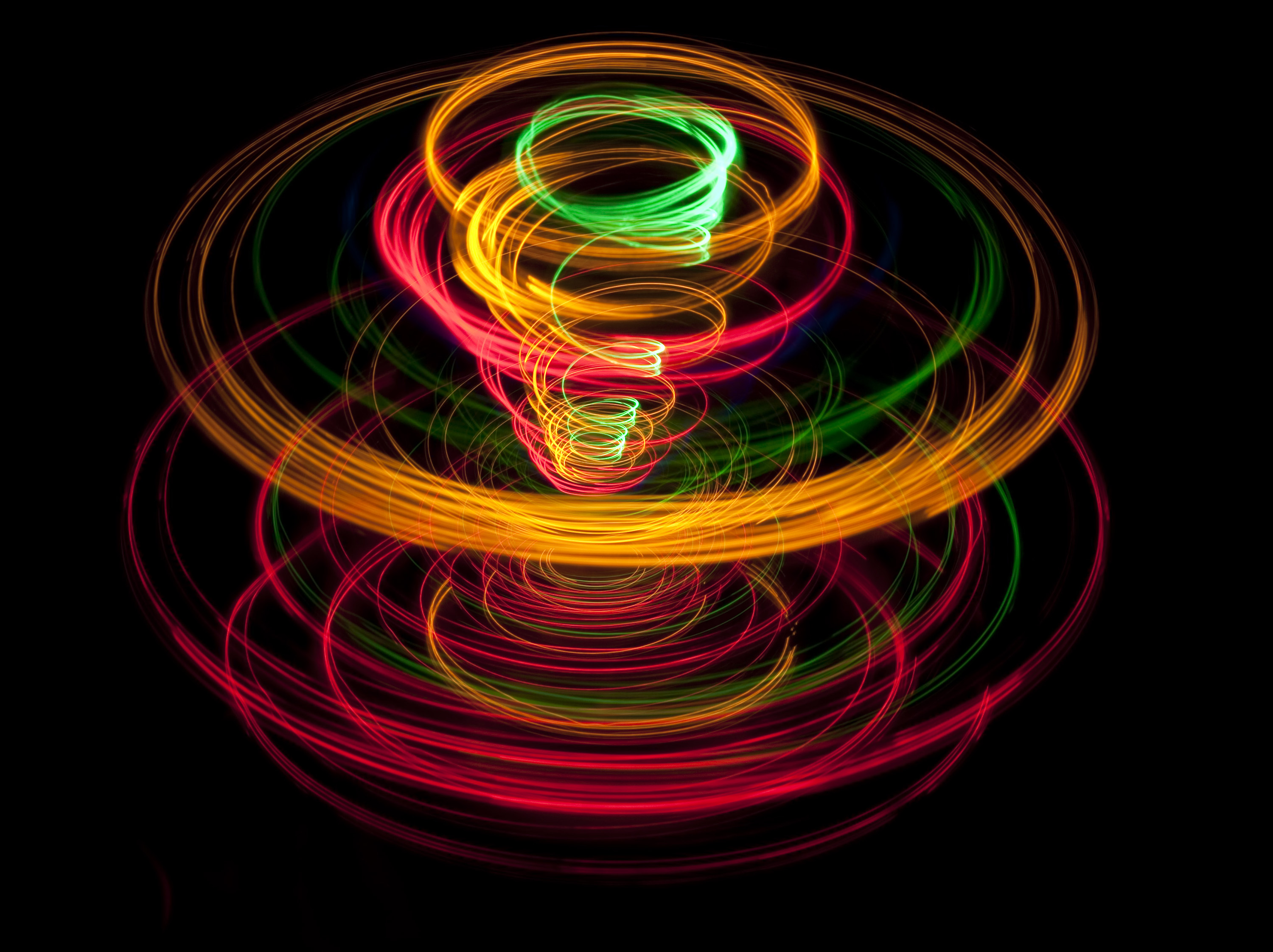 color and movement depicting in a spiraling pattern of light