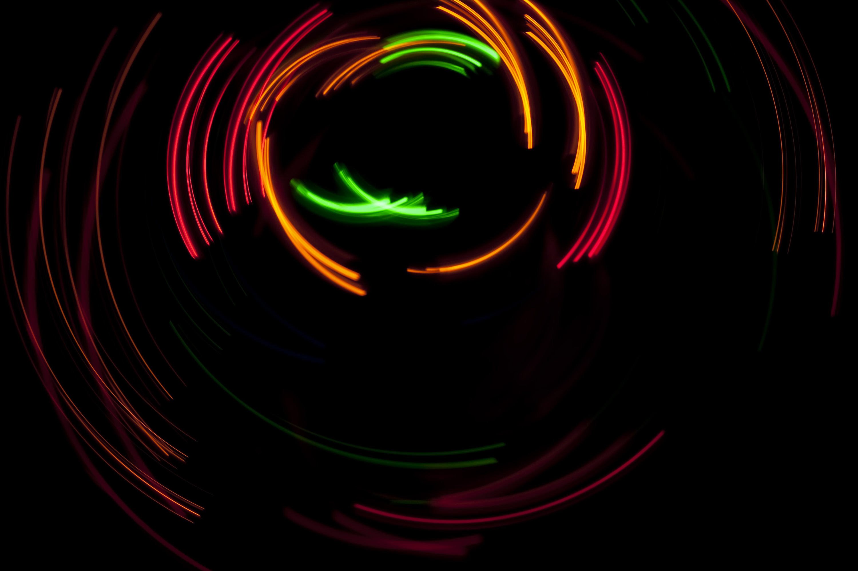 bright colours of curved light plotted on a black backdrop