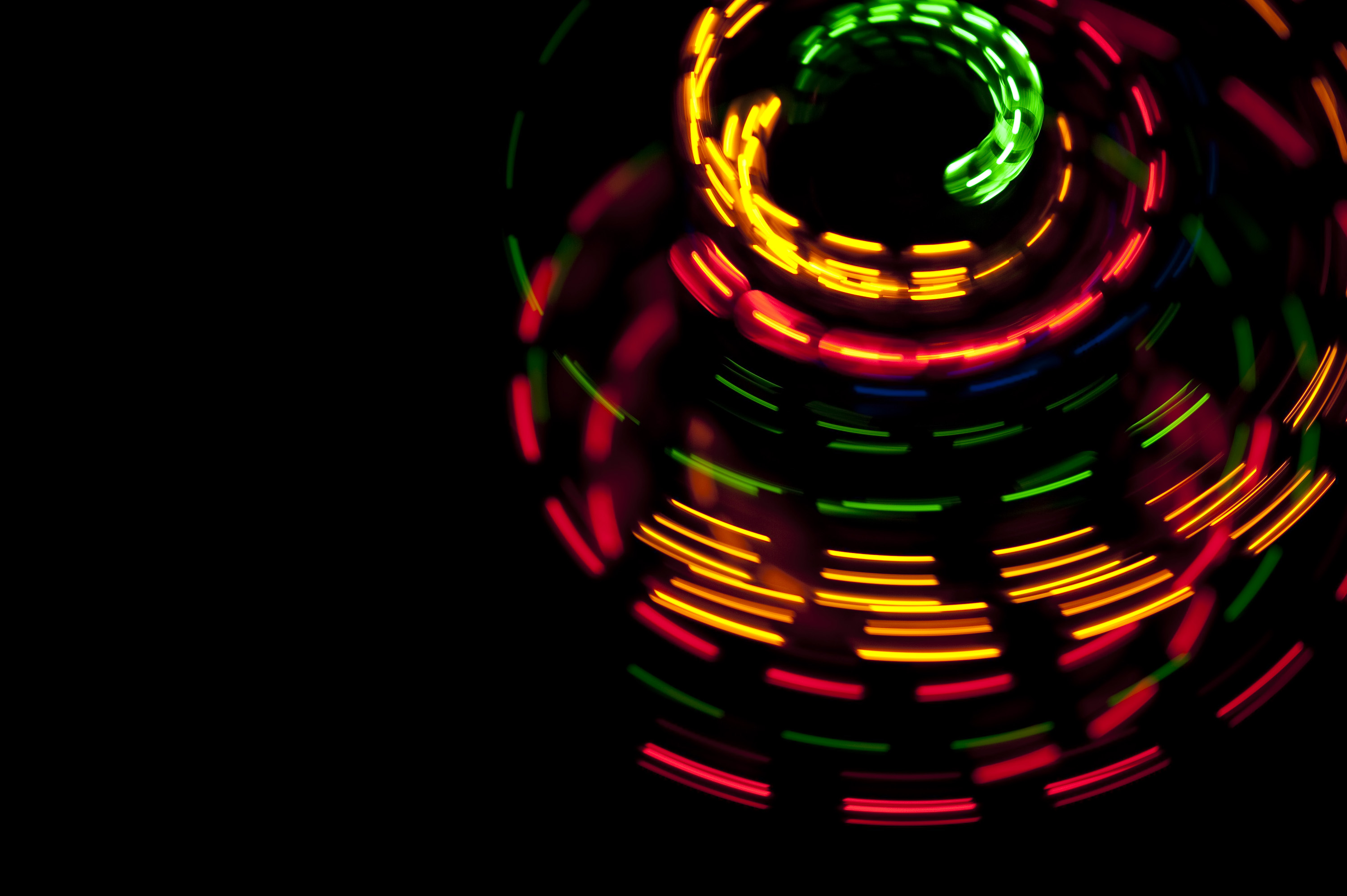 vividly colored dashed glowing lines creating  a circular rotating effect pattern