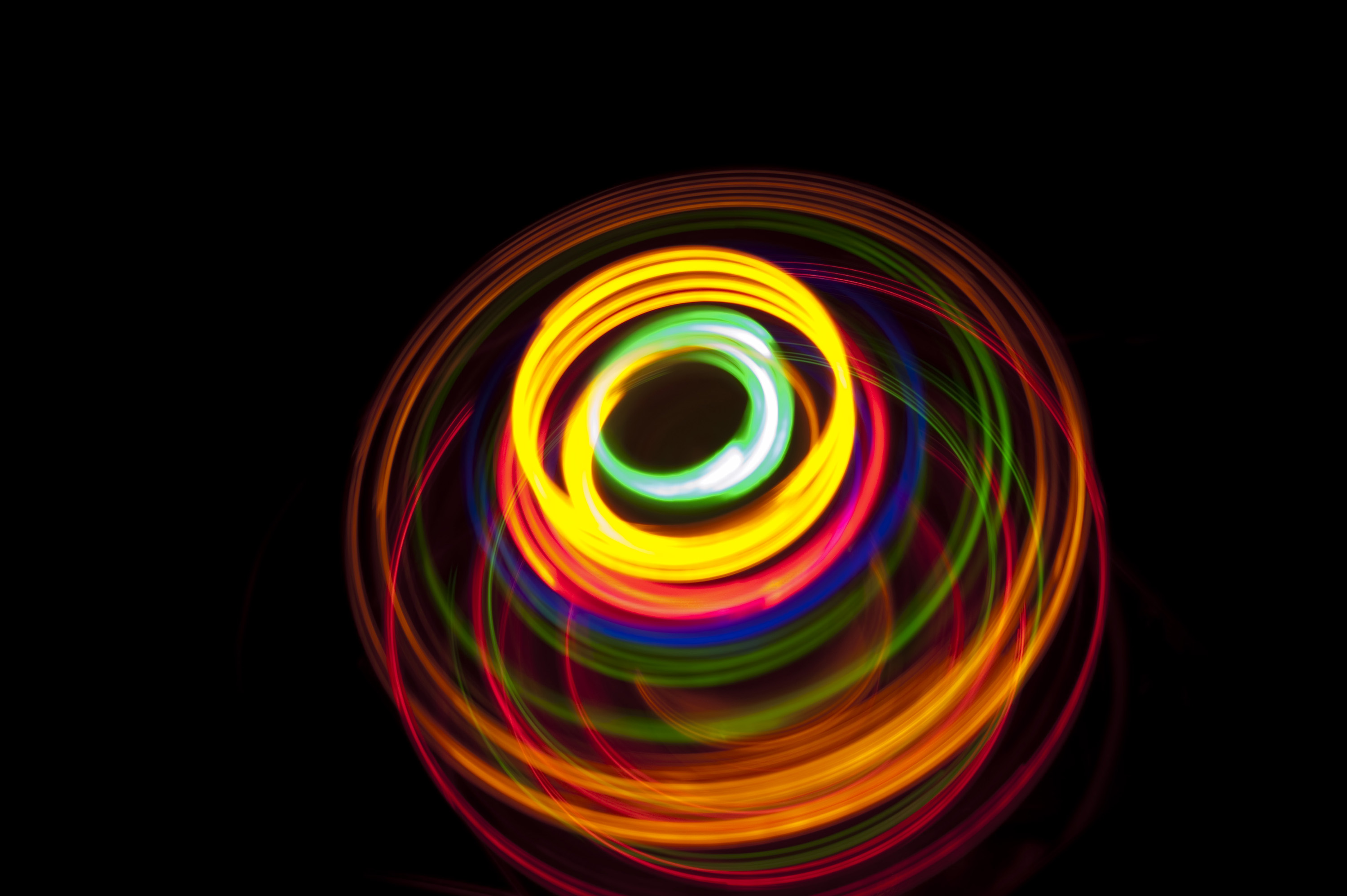 glowing overlapping circles of yellow orange red green and blue