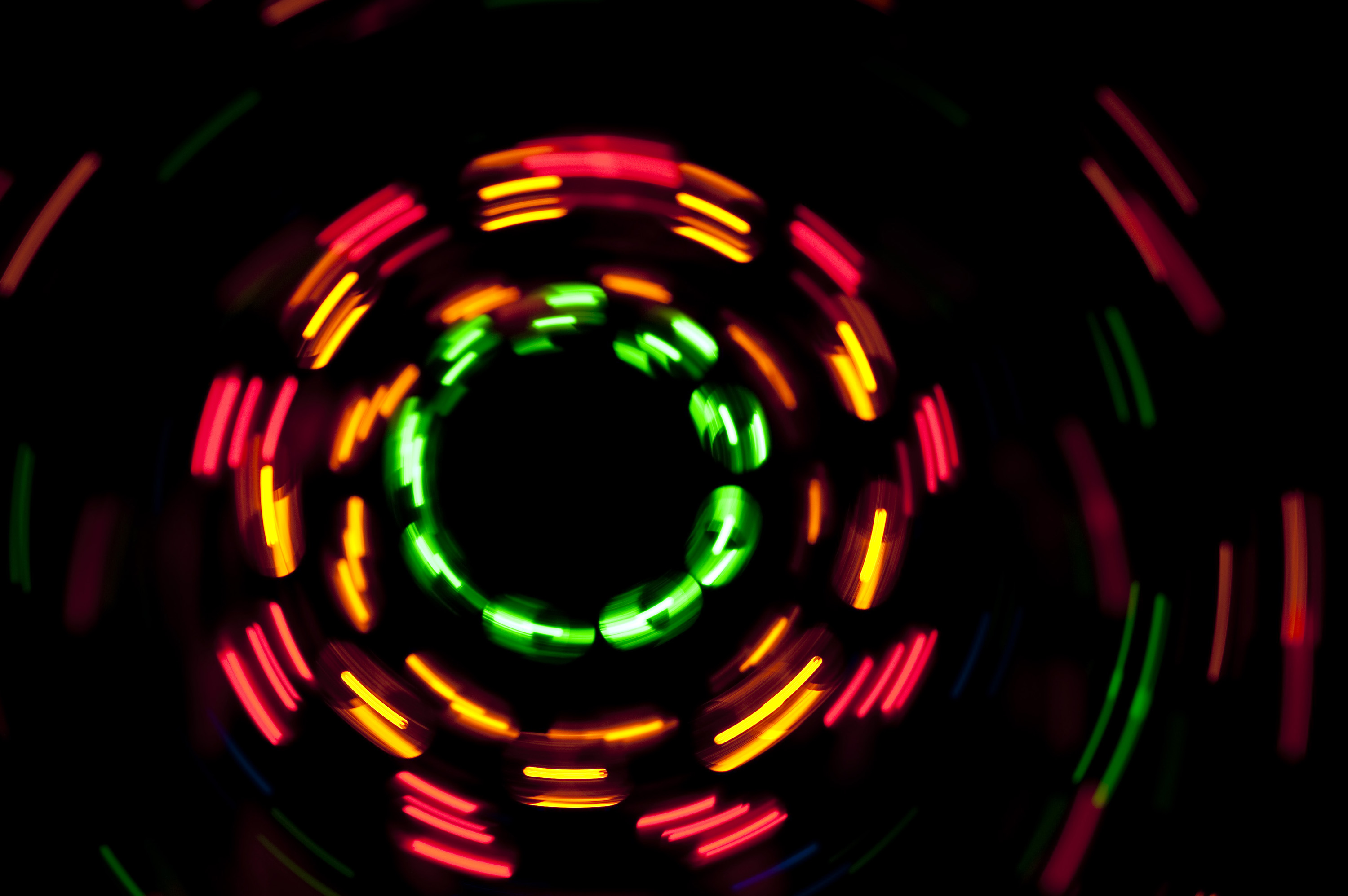 glowing dashes of light plotting concentric circles on a black background