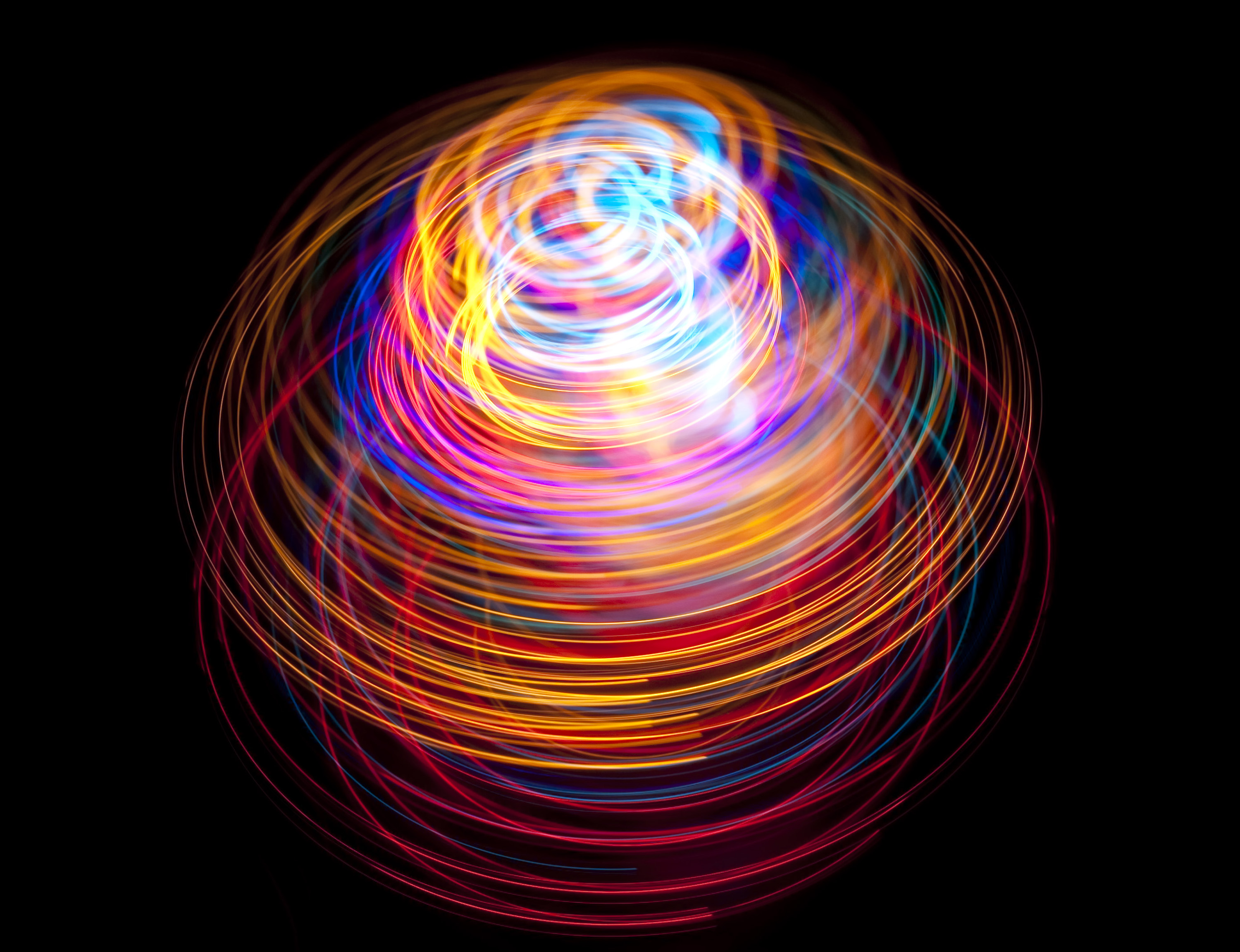 glowing colored light trails creating abstract forms and shapes