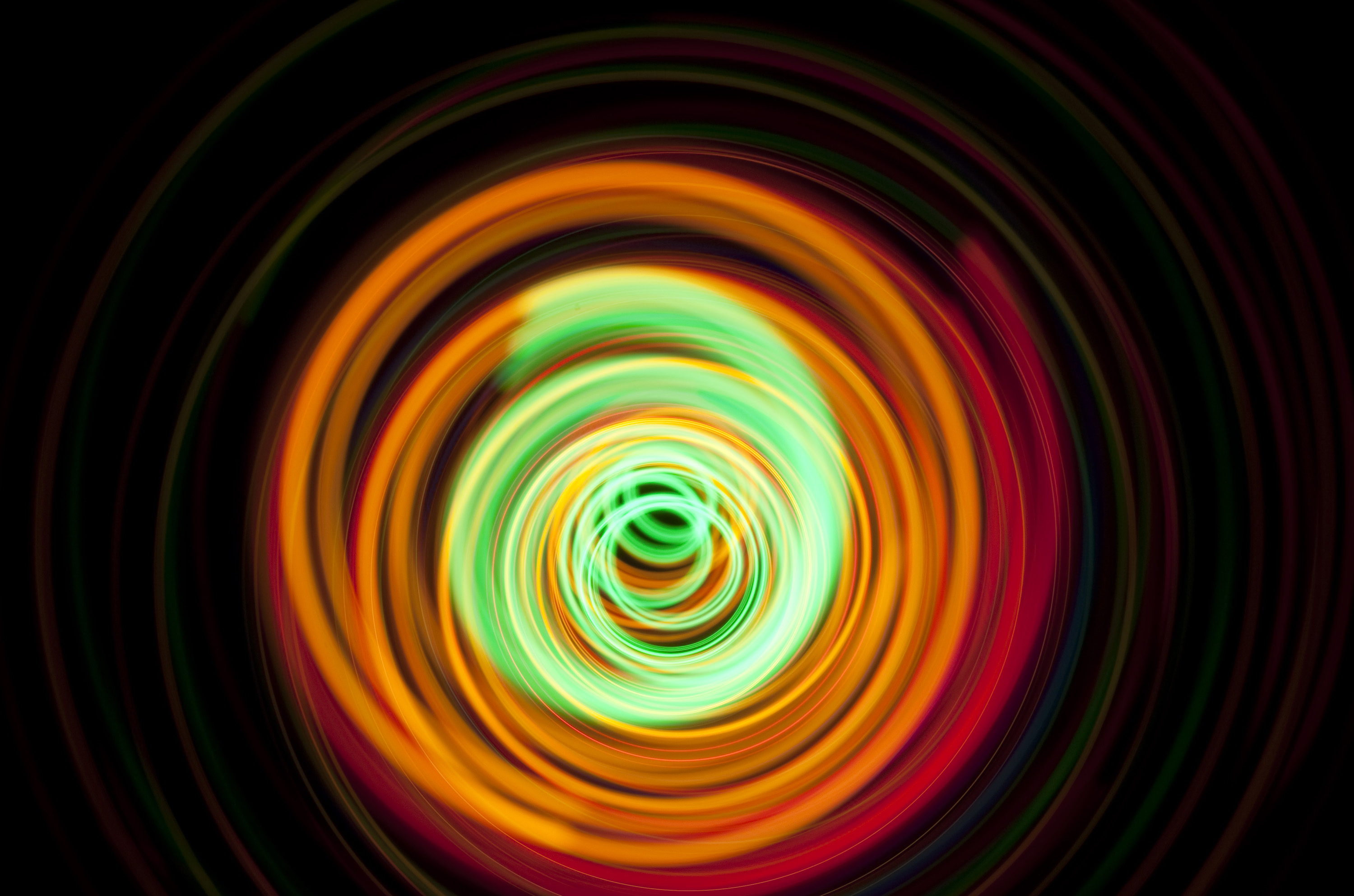 orange and green abstract spiraling light effect