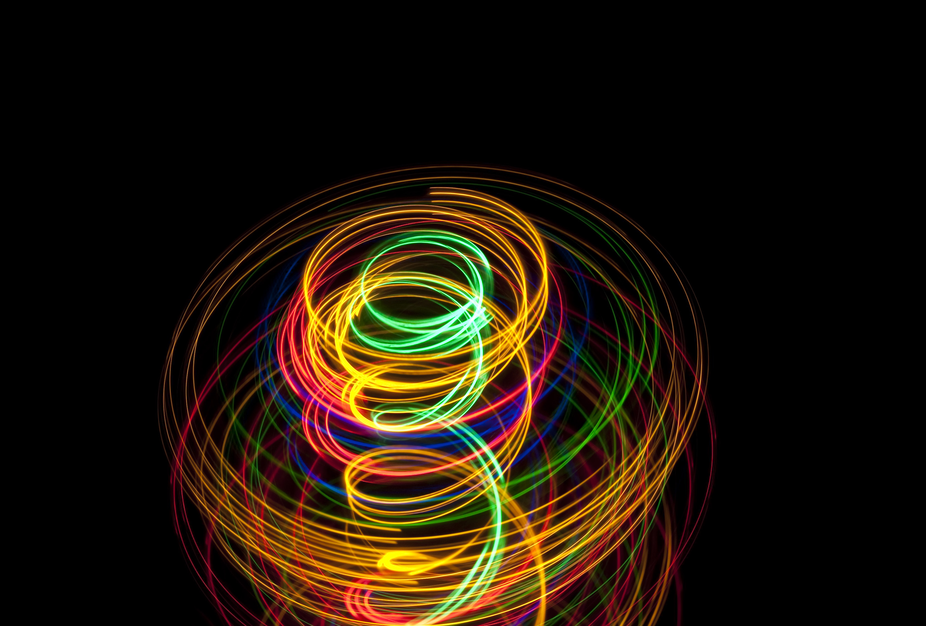 a vibrantly coloured spiral light effect with space for text
