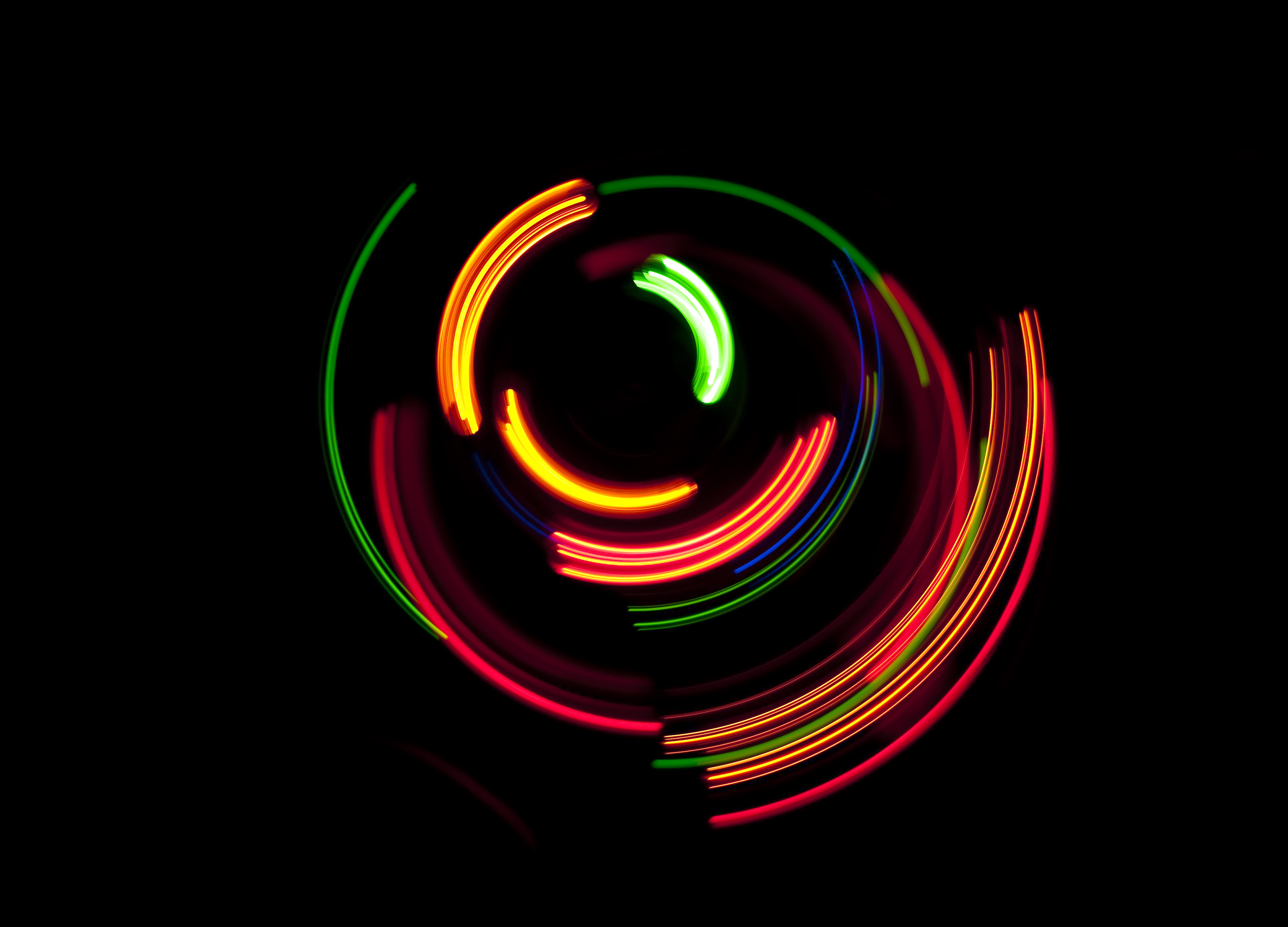 an interesting background image composed of bright vividly coloured arcs of light