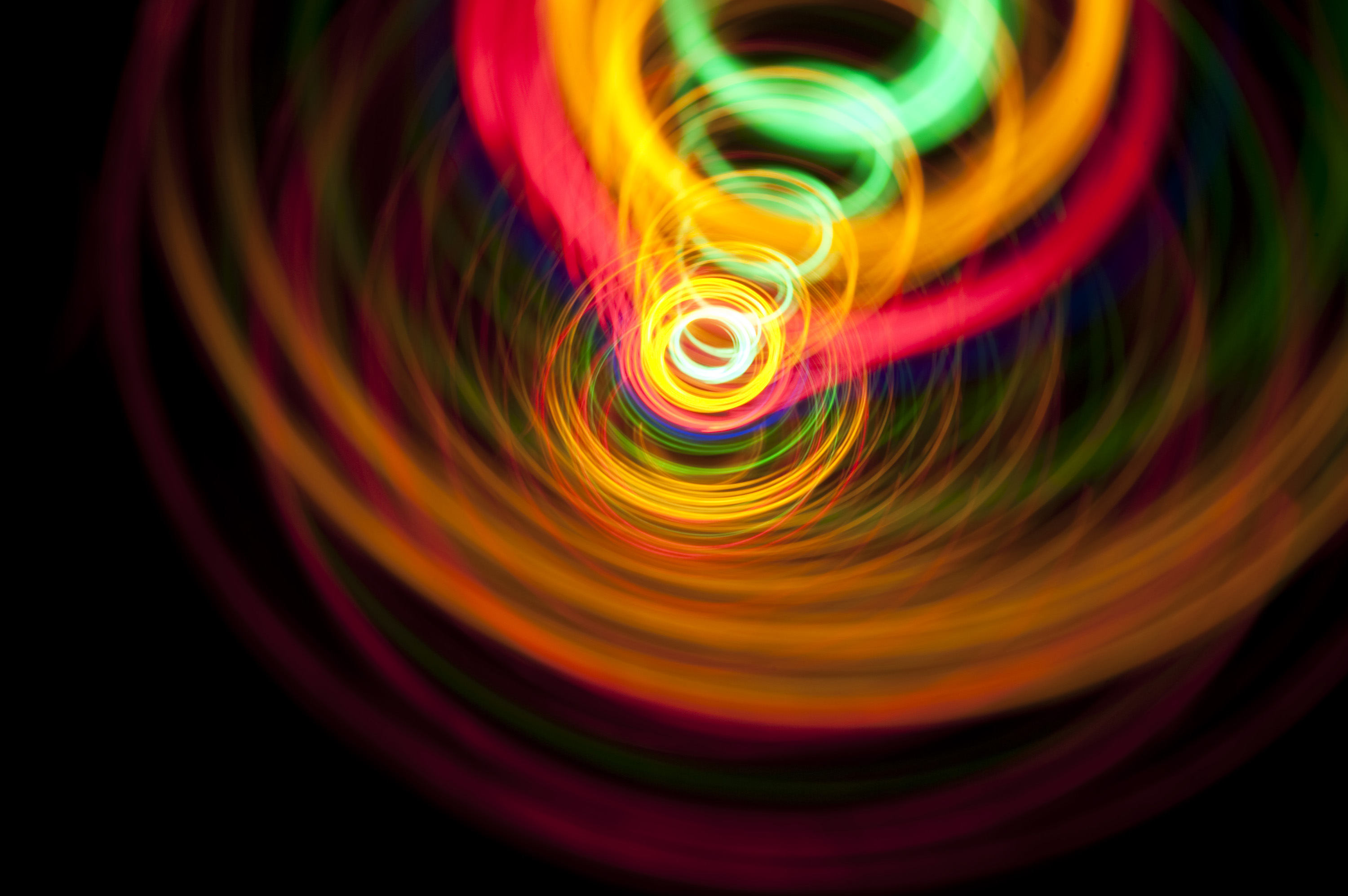 a vortex of spinning light creating a whirlpool effect