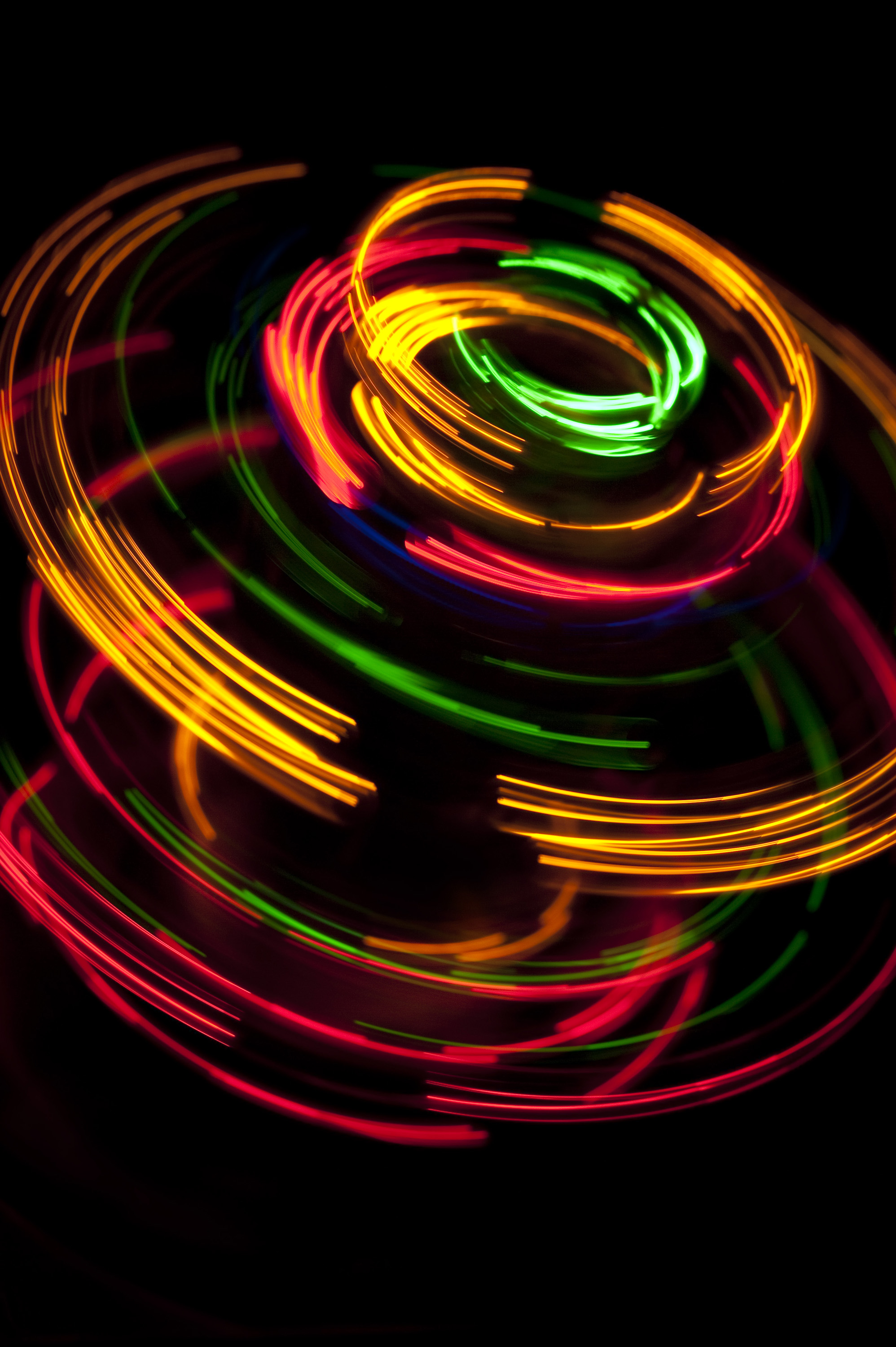 Colorful Series Of Overlapping Curved Lines Light Glowing Against A Black Background