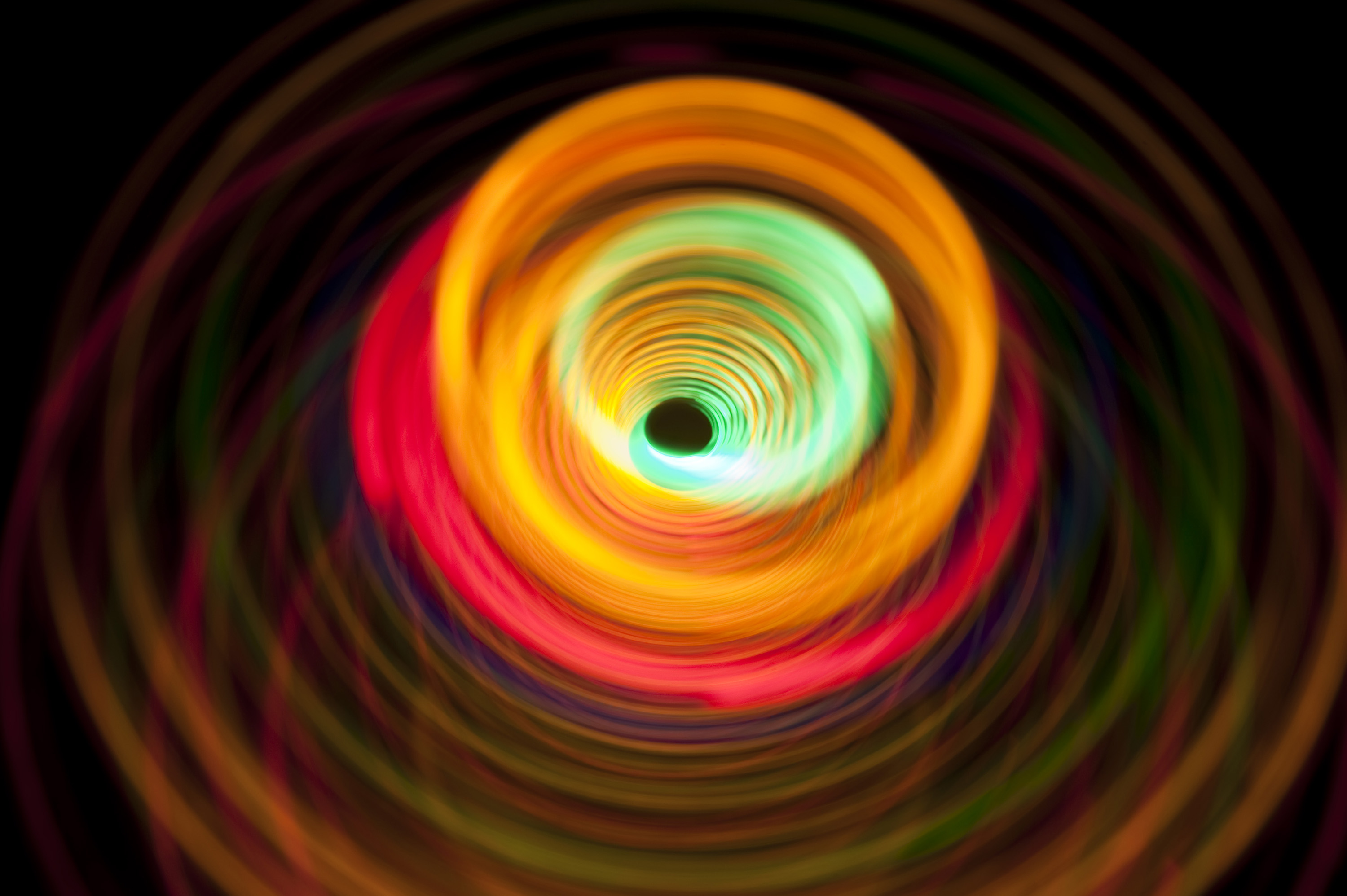 an image of colorful lights inspired by spinning motion