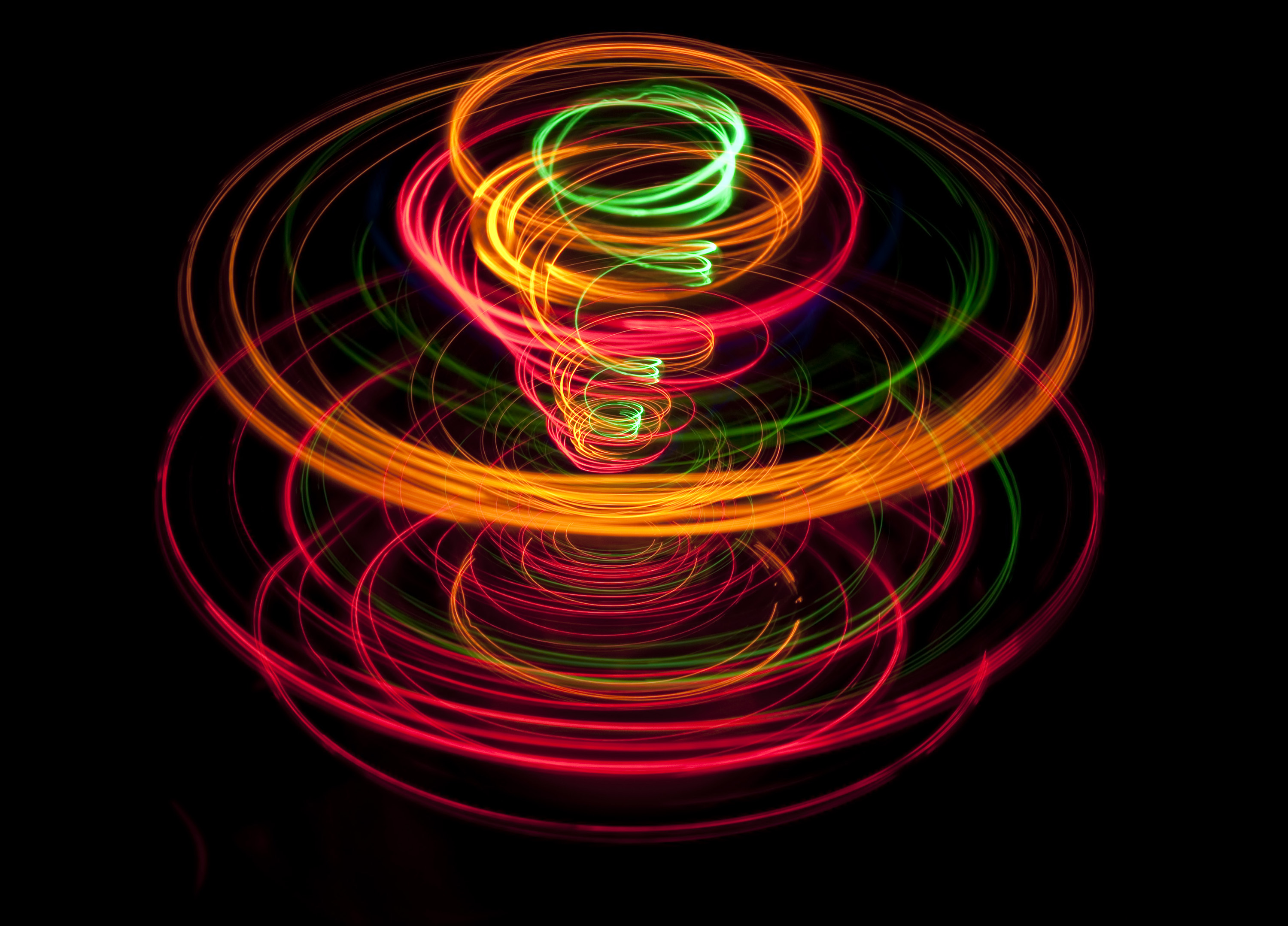 and expanding spiral of colored light