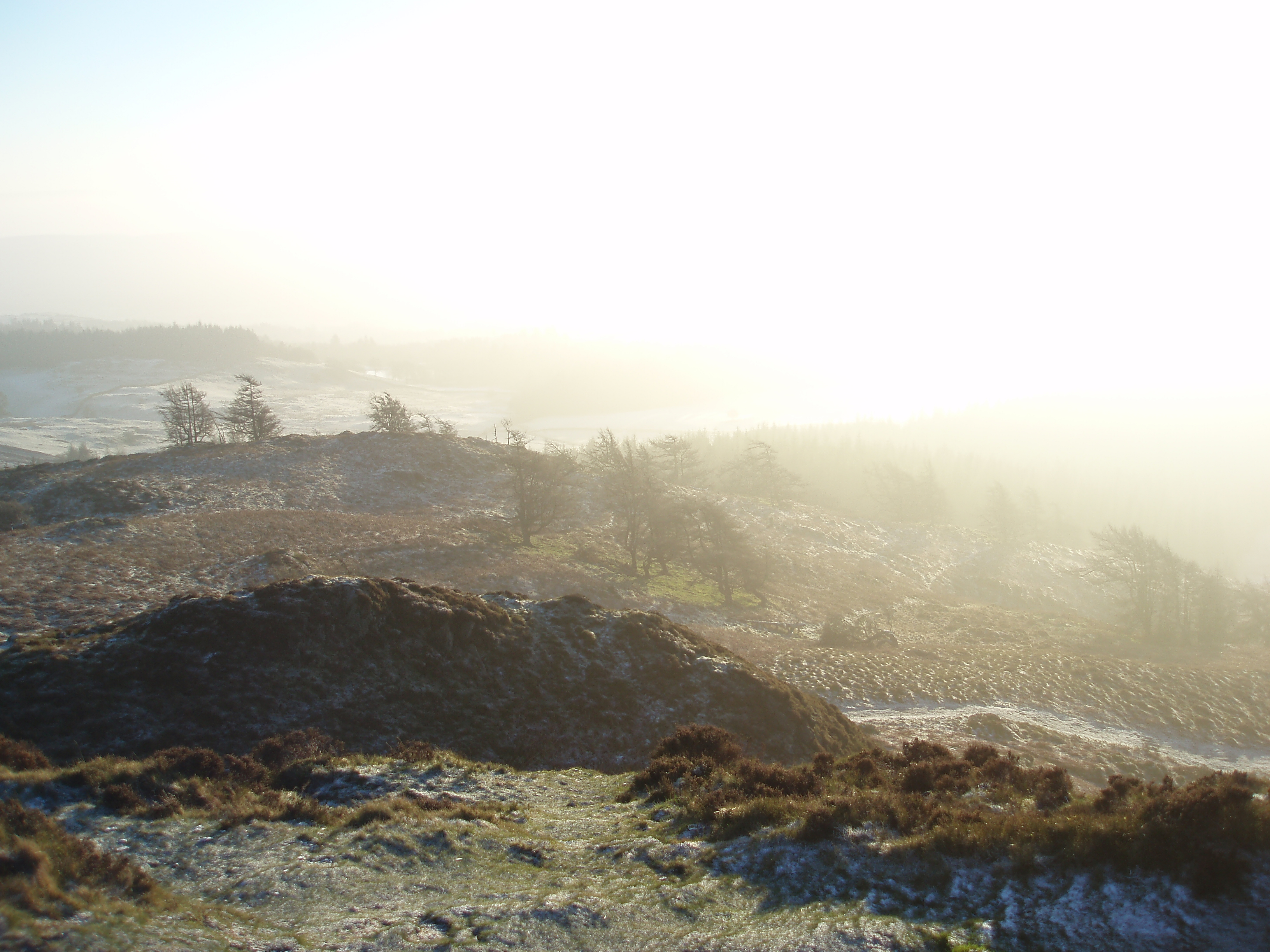 cumbria mountain top winter landscape with lens flare