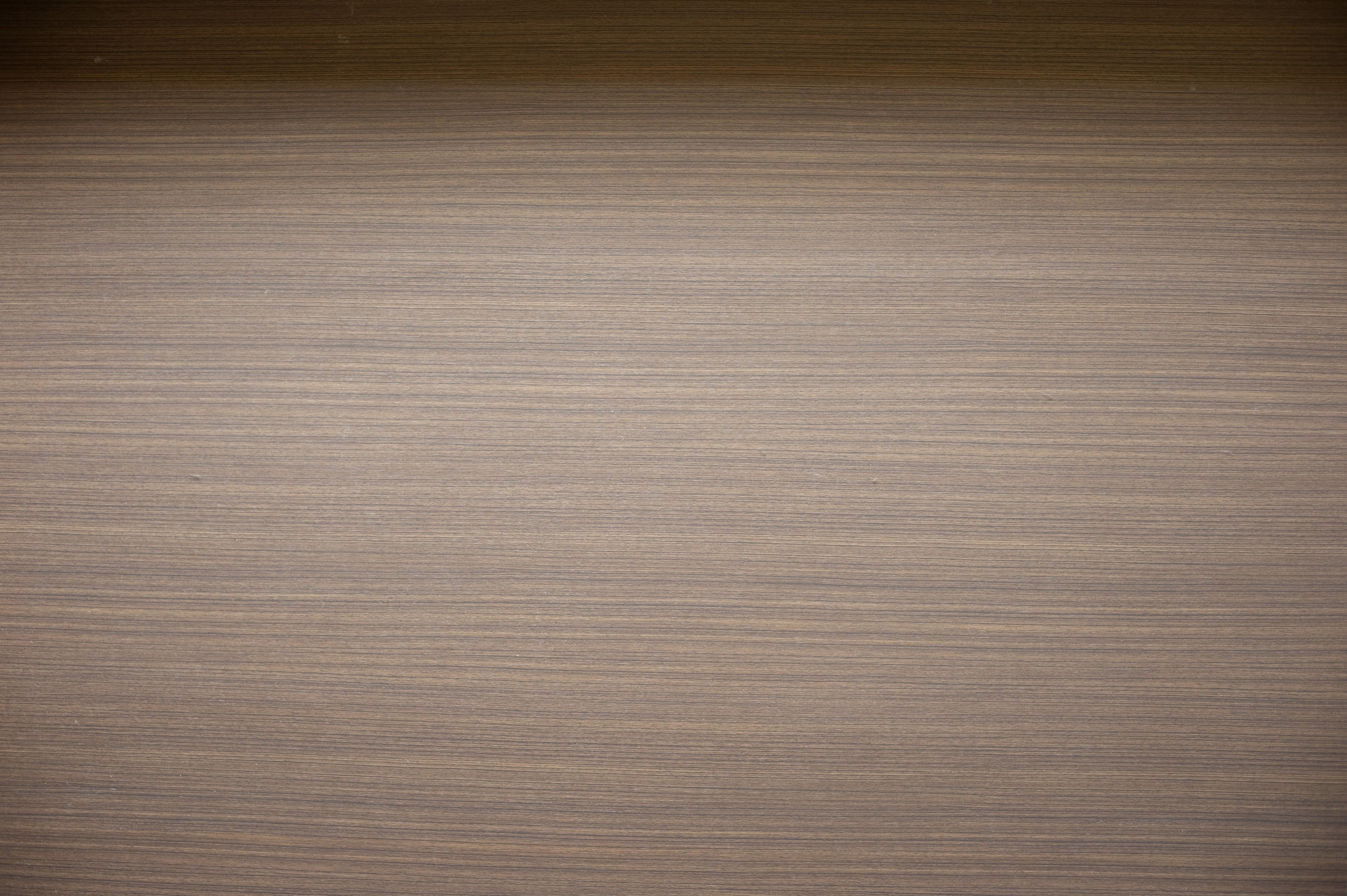 Background texture of faux wood made of plastic laminate for modern interior decorating