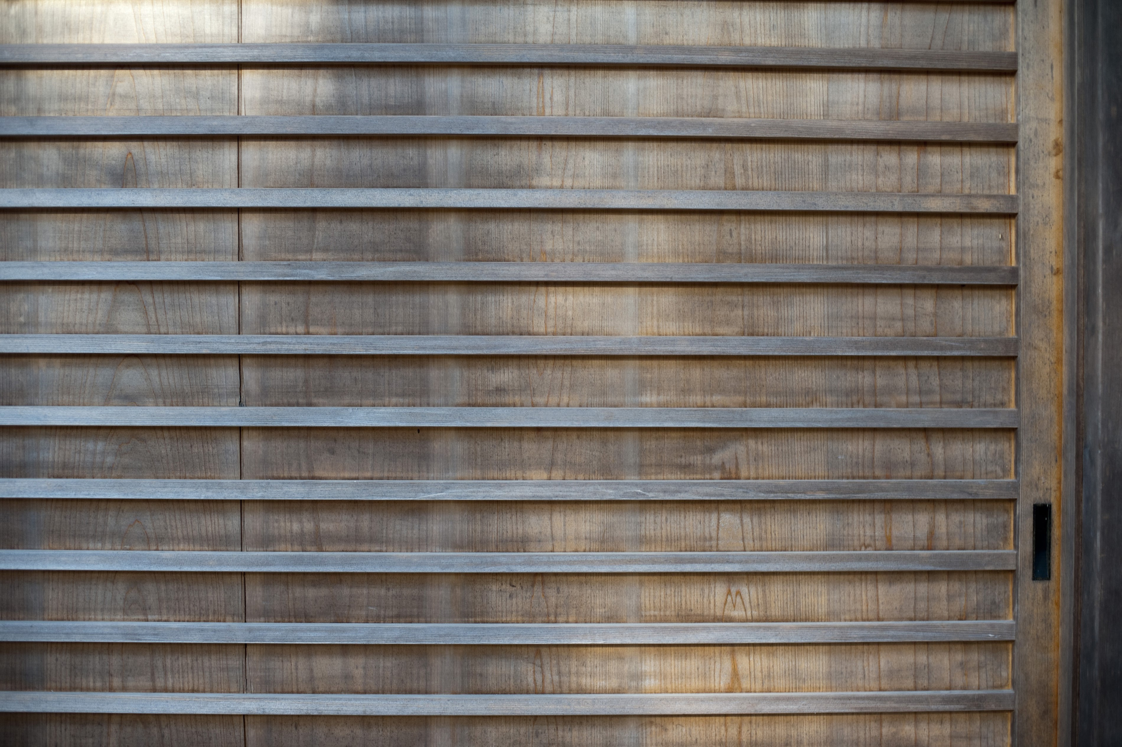 Background texture and pattern of thin parallel wood strips on an old wooden  panel